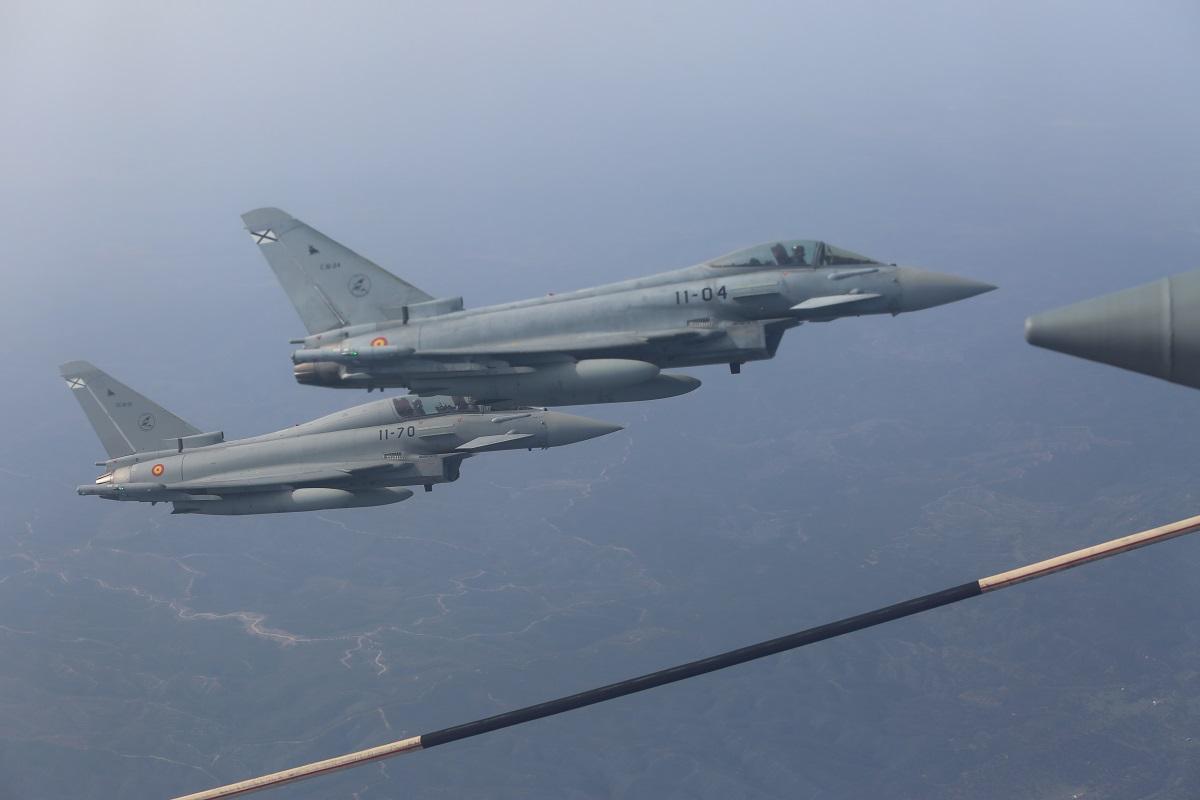 Spanish Air Force Eurofighter Typhoon jets hold security near a U.S Marine KC-130J aircraft. (Cpl. Patrick Osino/U.S. Marine Corps)