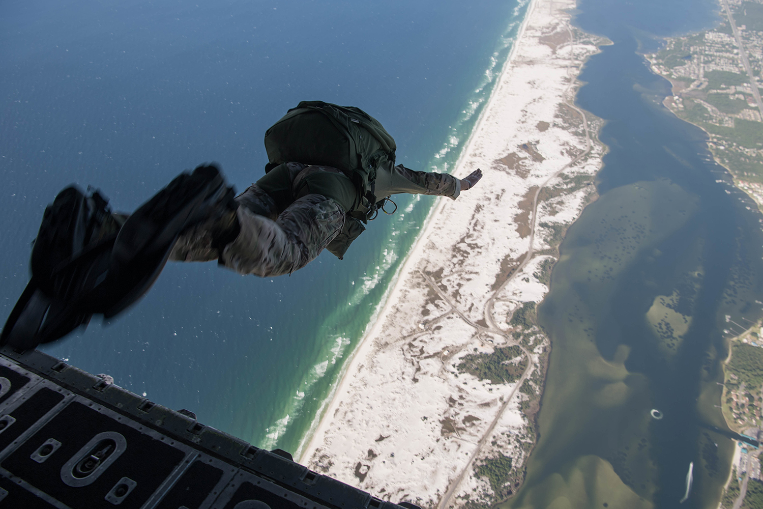 Col. Spencer Cocanour, 24th Special Operations Wing former acting commander, exits an MC-130H Combat Talon II during his final military free-fall jump at Hurlburt Field, Fla., Sept. 20, 2019. Cocanour is retiring after 24 years of service. (Staff Sgt. Rose Gudex/Air Force)