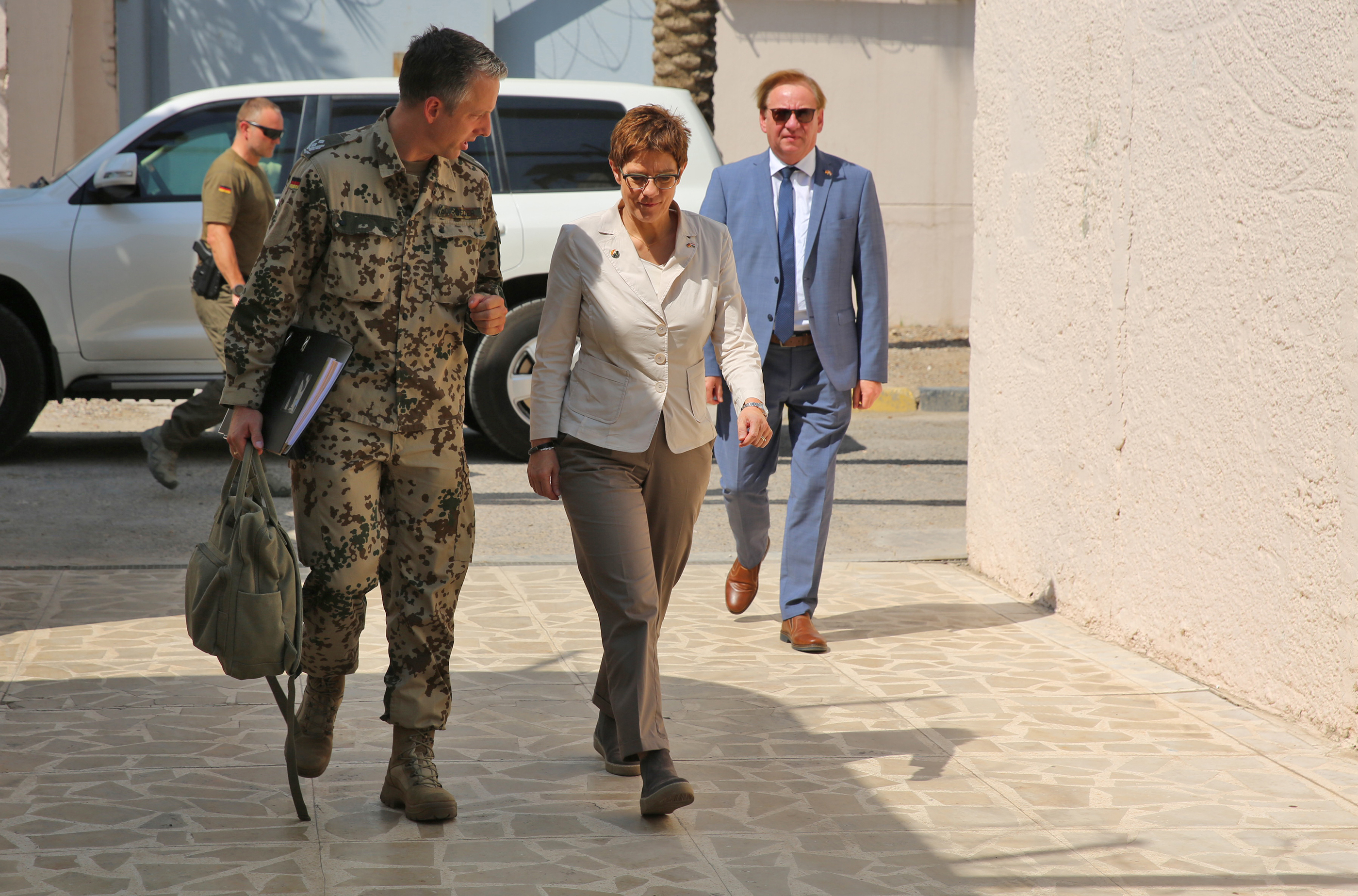 German Defense Minister Annegret Kramp-Karrenbauer (R) walks alongside a German army officer in the German Embassy durning her visit to Baghdad on Aug. 20, 2019. (Sabah Arar/AFP/Getty Images)