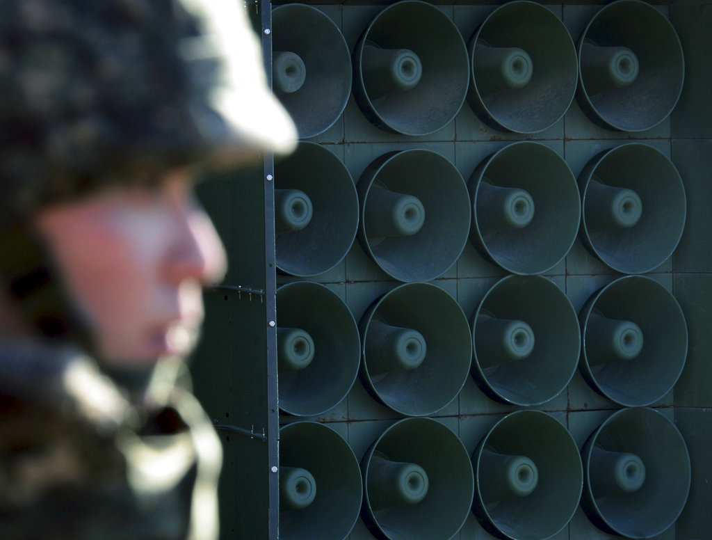 In this Jan. 8, 2016, file photo, a South Korean soldier stands near the loudspeakers near the border area between South Korea and North Korea in Yeoncheon, South Korea. South Korea says it has halted anti-Pyongyang propaganda broadcasts on the border ahead of the April 27, 2018, inter-Korean talks. (Lim Tae-hoon/Newsis via AP)