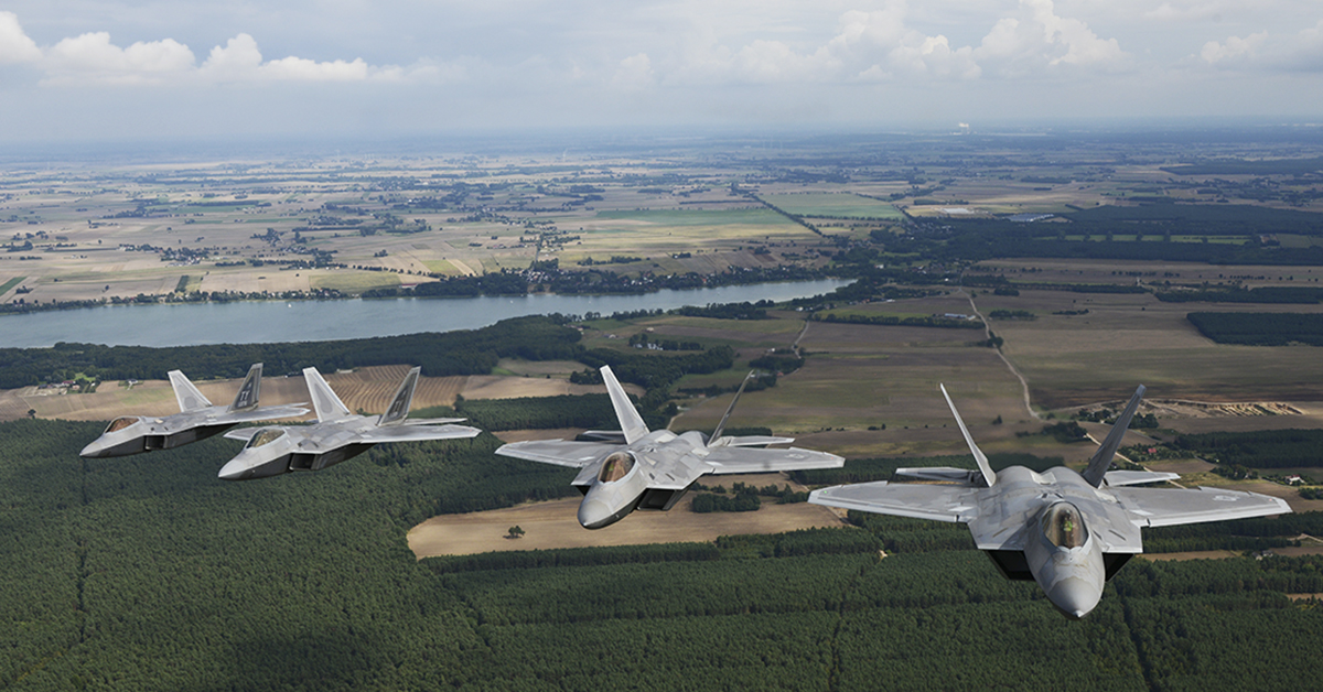 Four F-22 Raptors from the 95th Fighter Squadron, 325th Fighter Wing, Tyndall Air Force Base, Fla., participating in a multi-aircraft flyover in Warsaw, Poland during the 100th Anniversary of Polish Independence and Armed Forces Day. The F-22s forward deployed from Spangdahlem Air Base Germany, to Powidz Air Base, Poland on Aug. 14 for theater familiarization and to conduct interoperability with Polish and NATO aircraft. (SA Joshua Magbanua/Air Force)
