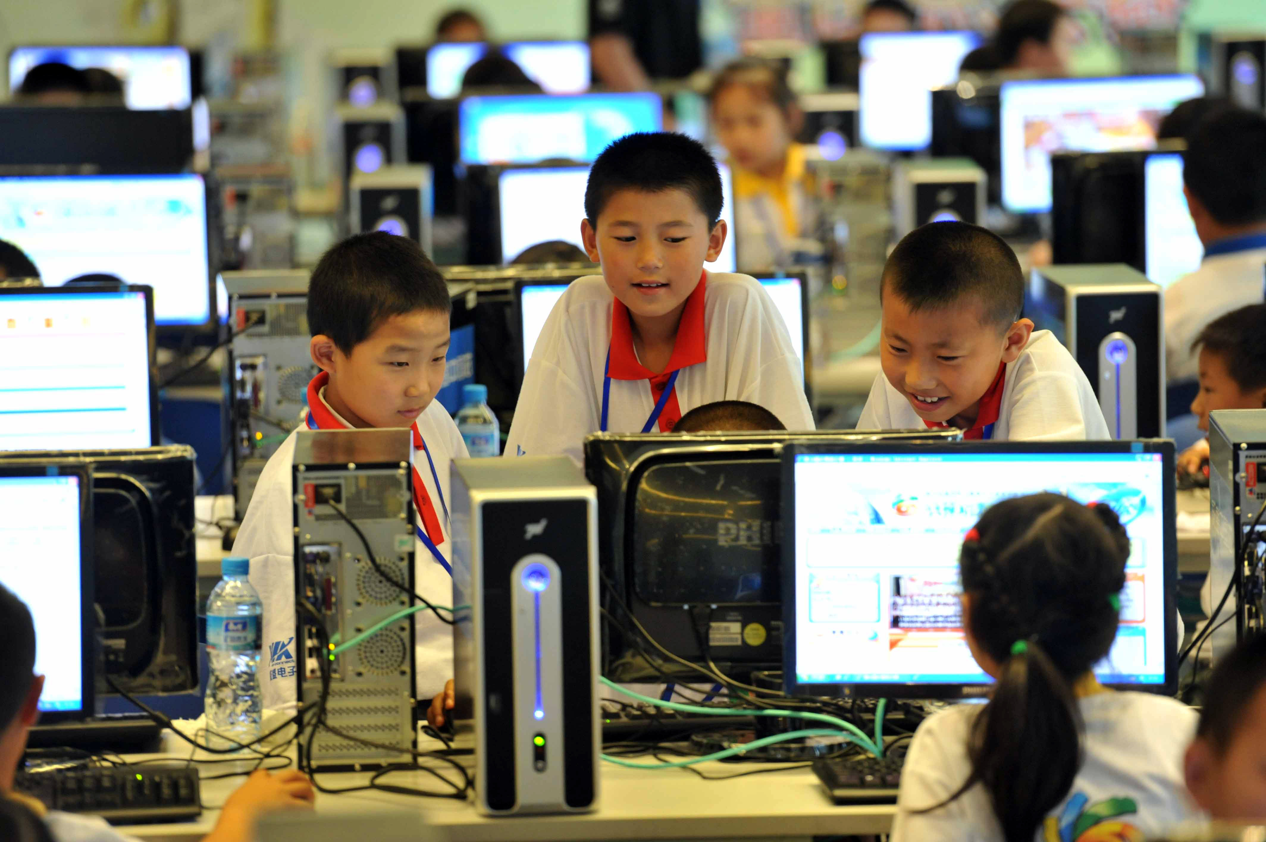 Chinese children attend a computer class to learn how to properly use the Internet in Beijing. (STR/AFP/Getty Images)