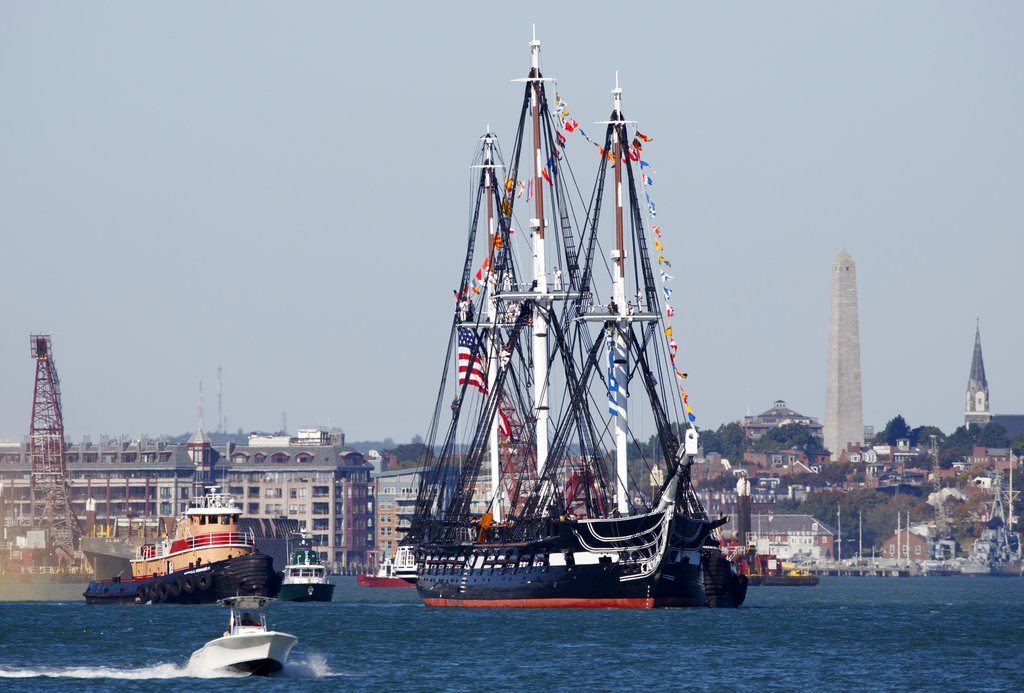 The USS Constitution heads towards Castle Island in Boston Harbor for a 21-gun salute, Friday, Oct. 20, 2017, in Boston. (Michael Dwyer/AP)