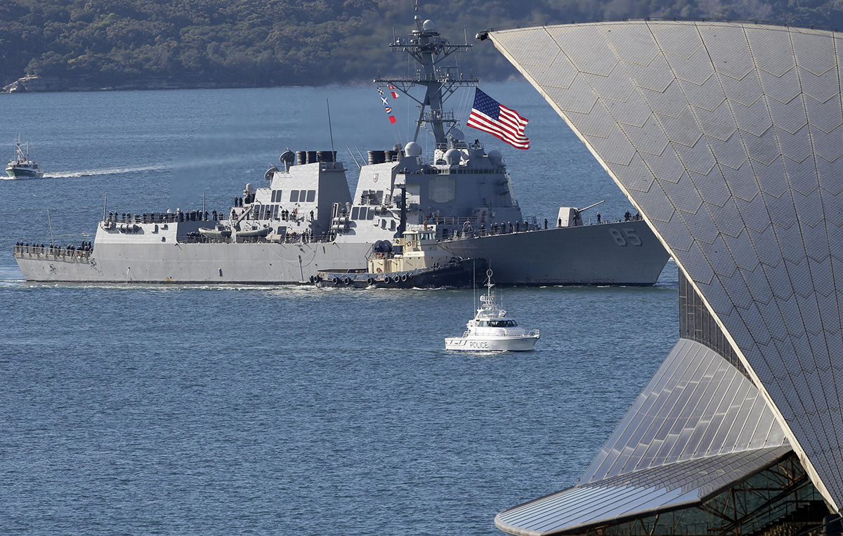 In this July 4, 2011, file photo, the U.S. guided-missile destroyer USS McCampbell (DDG 85) sails past the Opera House in Sydney, Australia, to berth alongside at Garden Island Naval base. (Rob Griffith/AP)