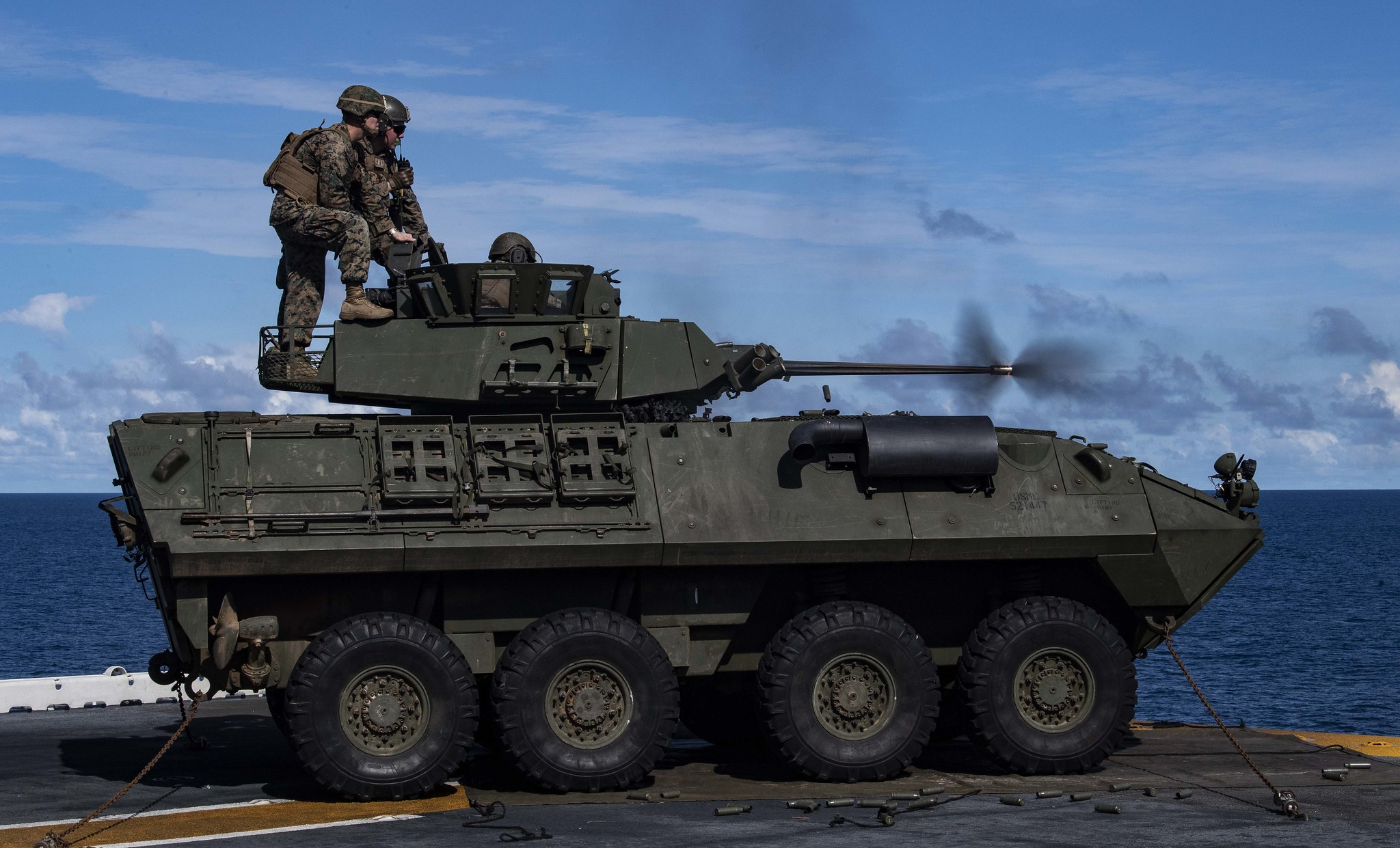 Marines fire a Light Armored Vehicle (LAV) M242 Bushmaster 25mm chain gun during a drill aboard the amphibious assault ship USS Wasp (LHD 1) Aug. 7, 2019, in the Pacific Ocean. (Mass Communication Specialist 1st Class Jeremy Starr/Navy)