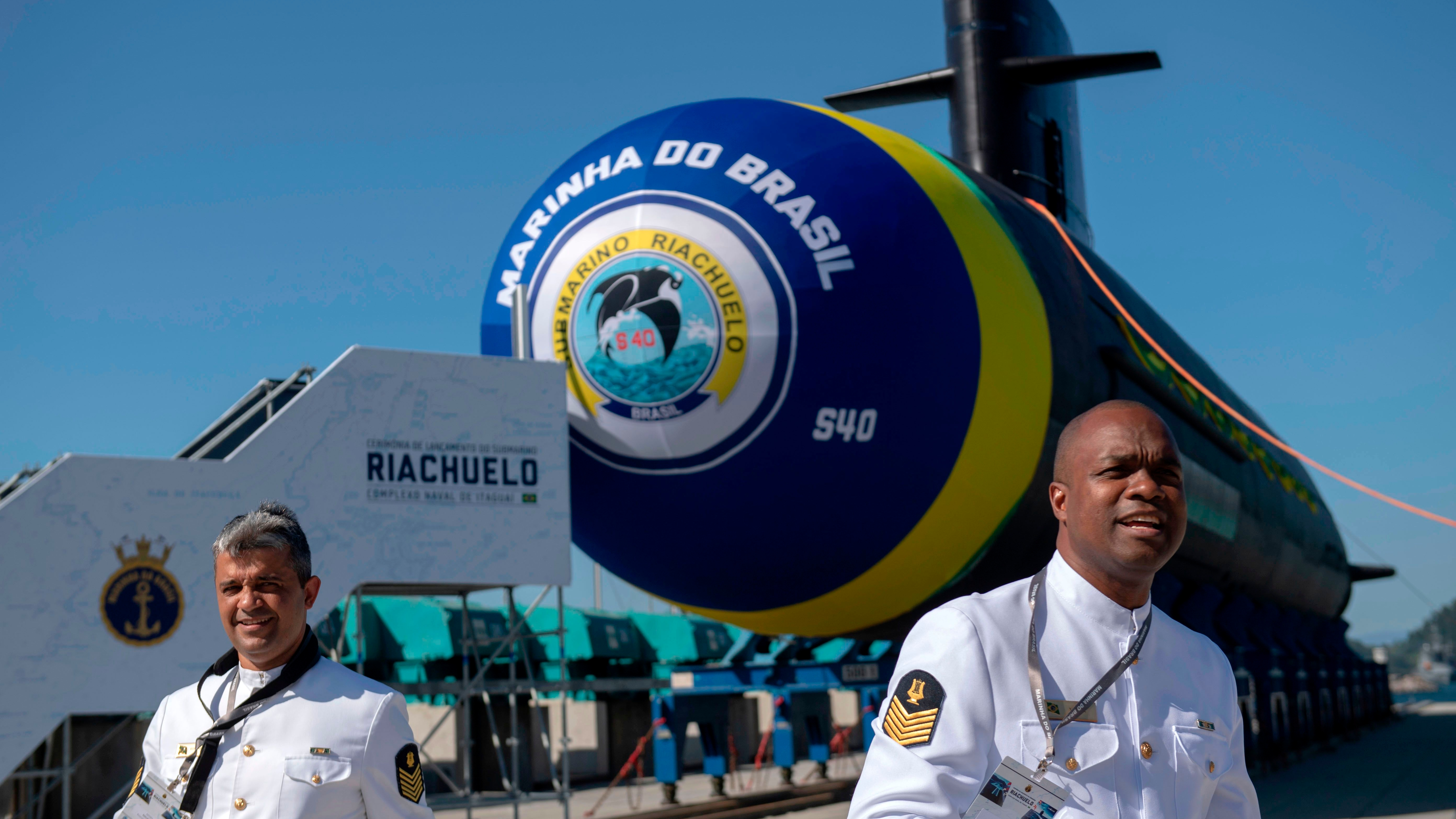 Brazilian Navy officers walk by the Riachuelo submarine during its launch ceremony at a navy base in Itaguai city, Rio de Janeiro state, Brazil, on Dec. 14, 2018. (Photo by Mauro Pimentel/AFP/Getty Images)