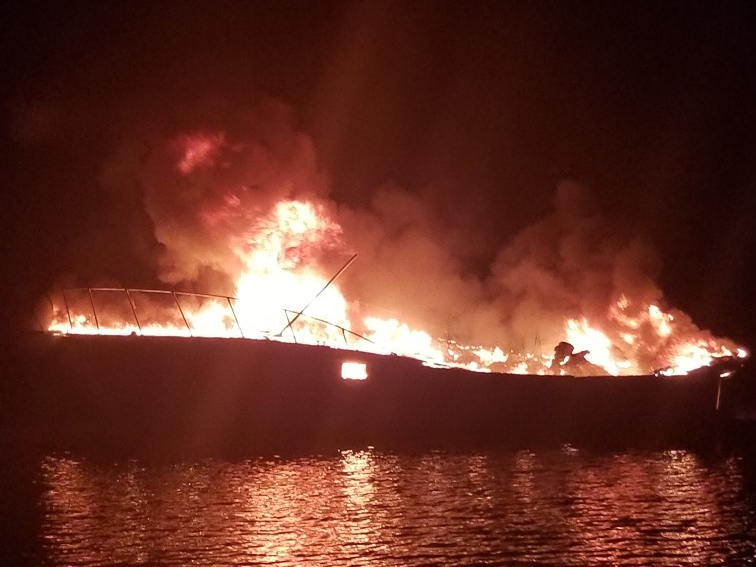 A 29-foot Response Boat-Small crew from Coast Guard Station Dauphin Island helps Dauphin Island Fire Rescue fight a fire on board a fishing vessel off Alabama on Wednesday. (Coast Guard courtesy photo)