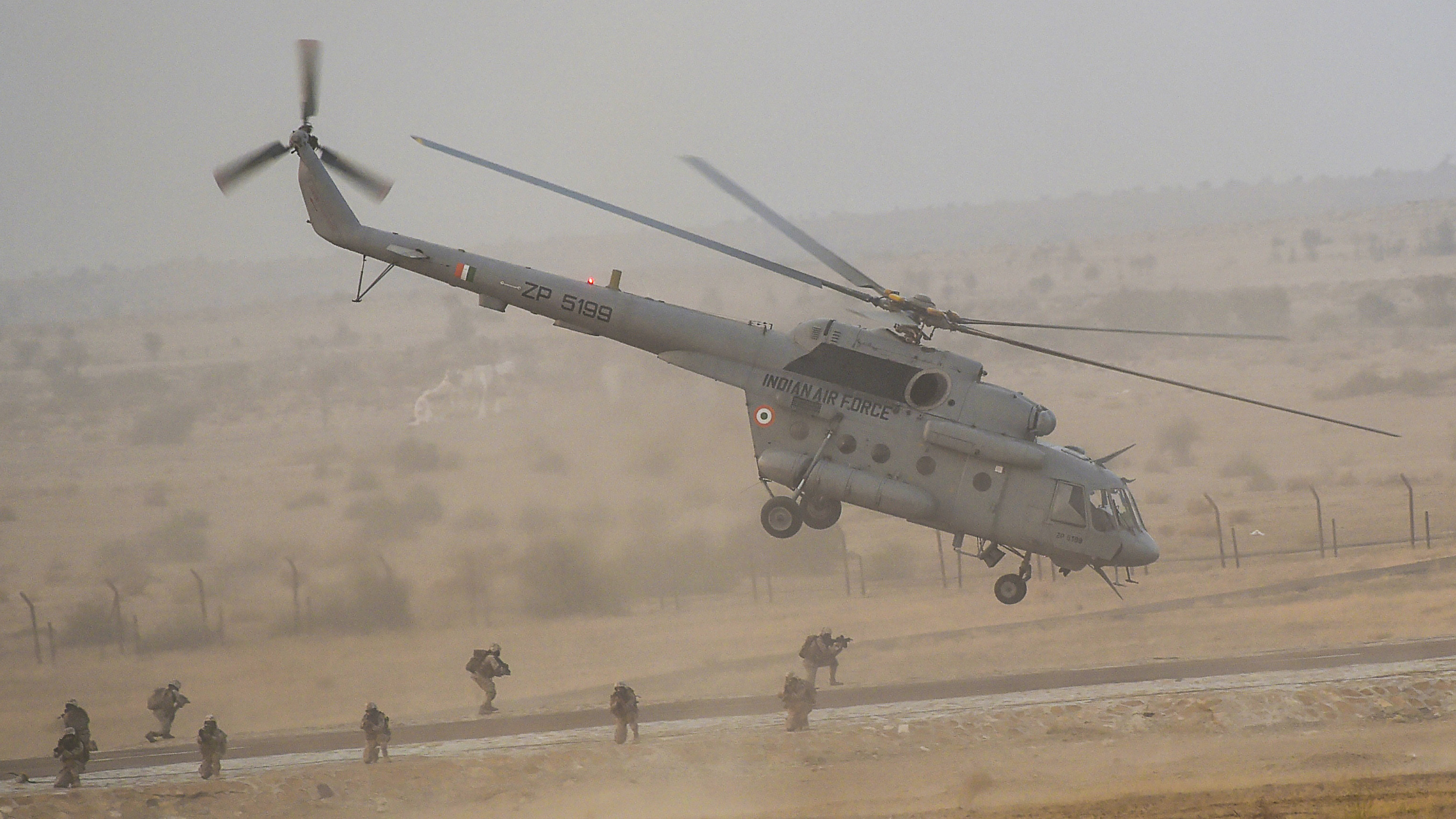 An Indian Air Force (IAF) helicopter takes off after dropping IAF's Garud commandos during 'Vayu Shakti' exercise at Pokharan, in Rajasthan on Feb. 16, 2019. (SAM PANTHAKY/AFP/Getty Images)