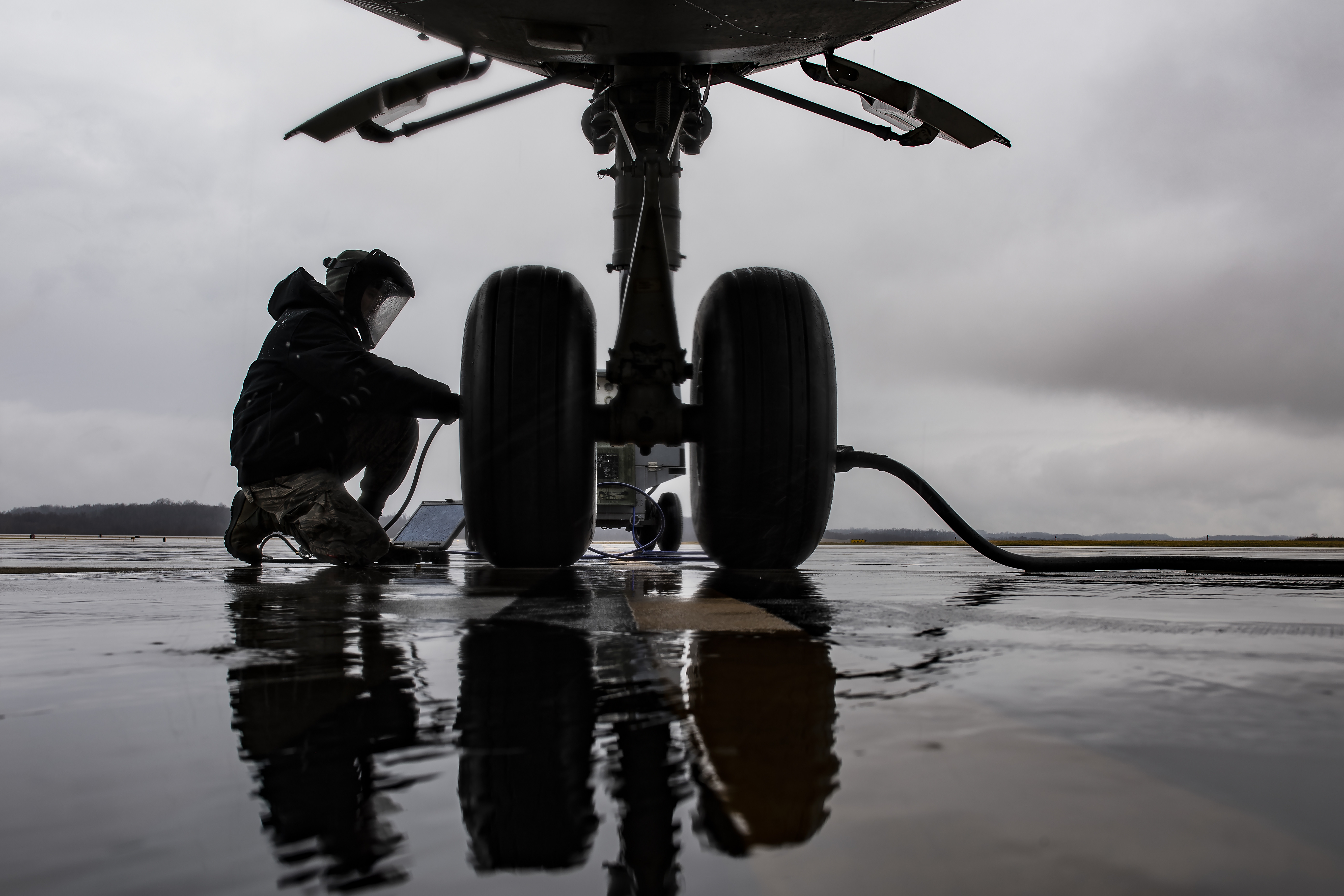 Senior Airman Zachary Anderson, 911th Aircraft Maintenance Squadron crew chief, services a nose landing-gear tire on a C-17 Globemaster III at the Pittsburgh International Airport Air Reserve Station, Pa., Feb. 26, 2020. (Joshua J. Seybert/Air Force)