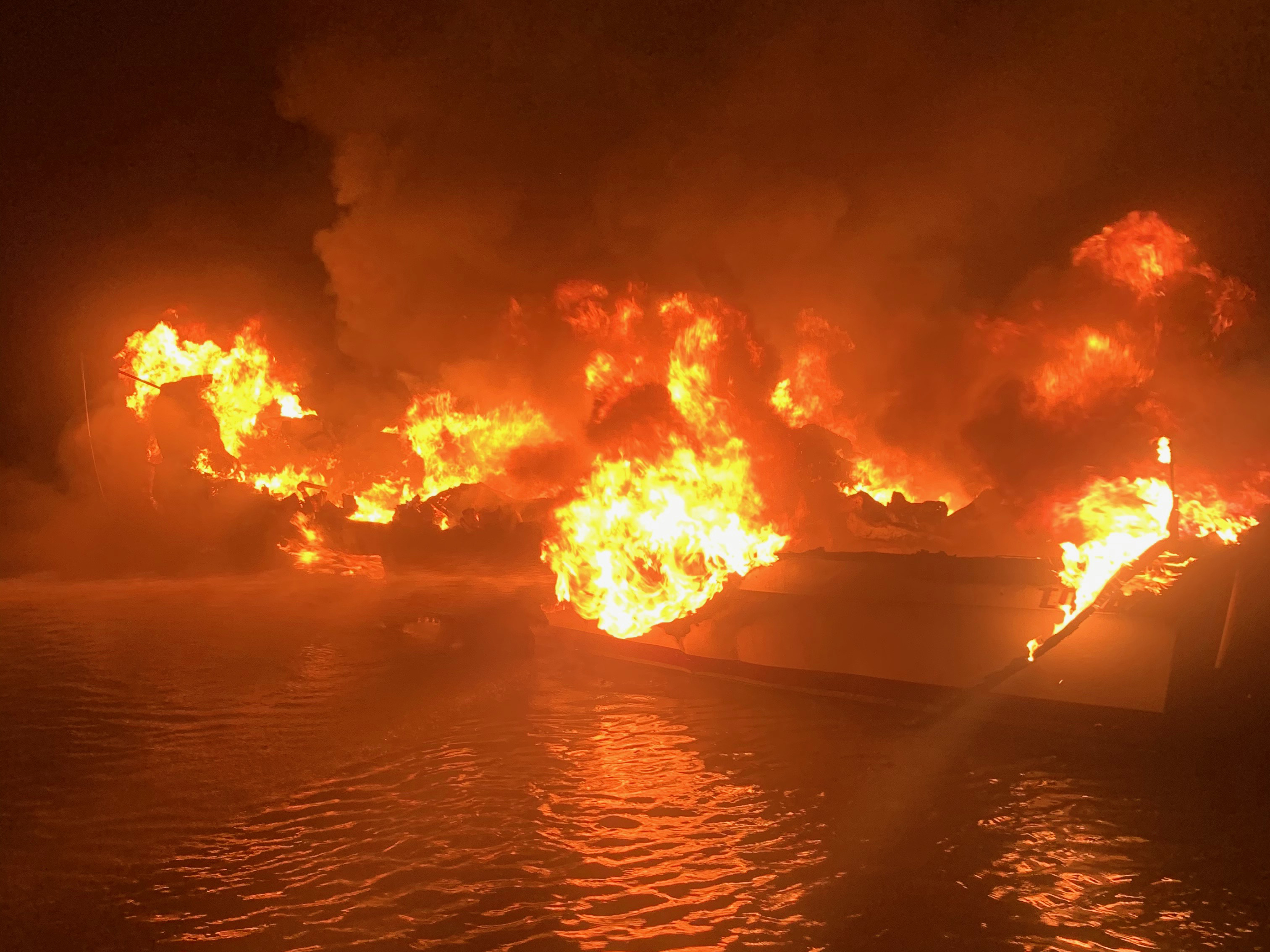 A 29-foot Response Boat-Small crew from Coast Guard Station Dauphin Island helps Dauphin Island Fire Rescue fight a fire on board a fishing boat Wednesday night. (U.S.Coast Guard courtesy photo)