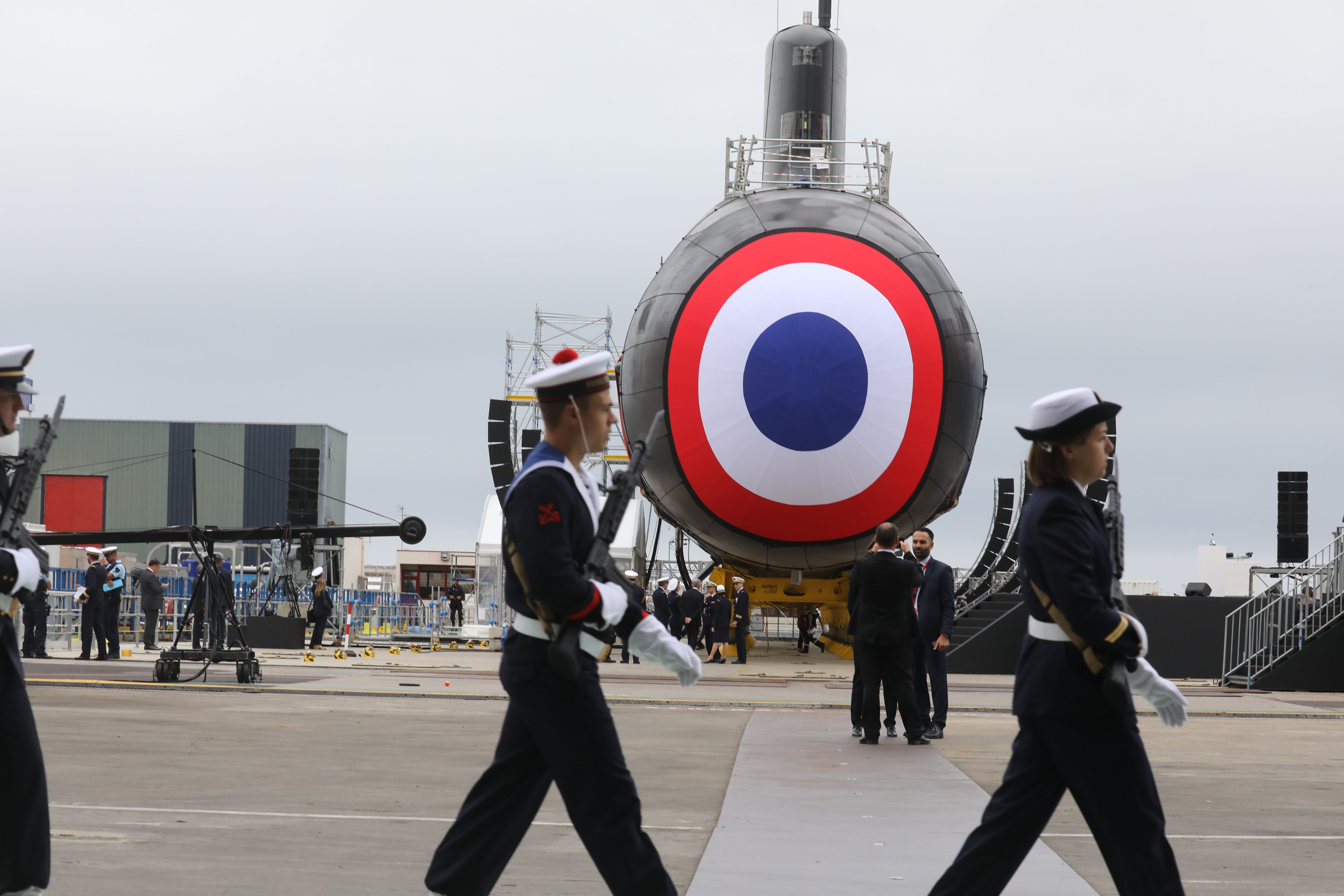 French National Marine members parade in front of the nuclear submarine Suffren in the Naval Group shipyard in Cherbourg, northwestern France, on July 12, 2019. (Ludovic Marin/AFP via Getty Images)