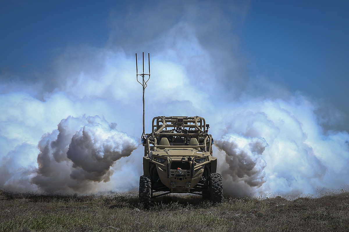 A screening obscuration module attached to a Utility Task Vehicle is autonomously activated during the robotic complex breach concept on Yakima Training Center in Yakima, Wash., April 26, 2019. (Lance Cpl. Nathaniel Q. Hamilton/Marine Corps)
