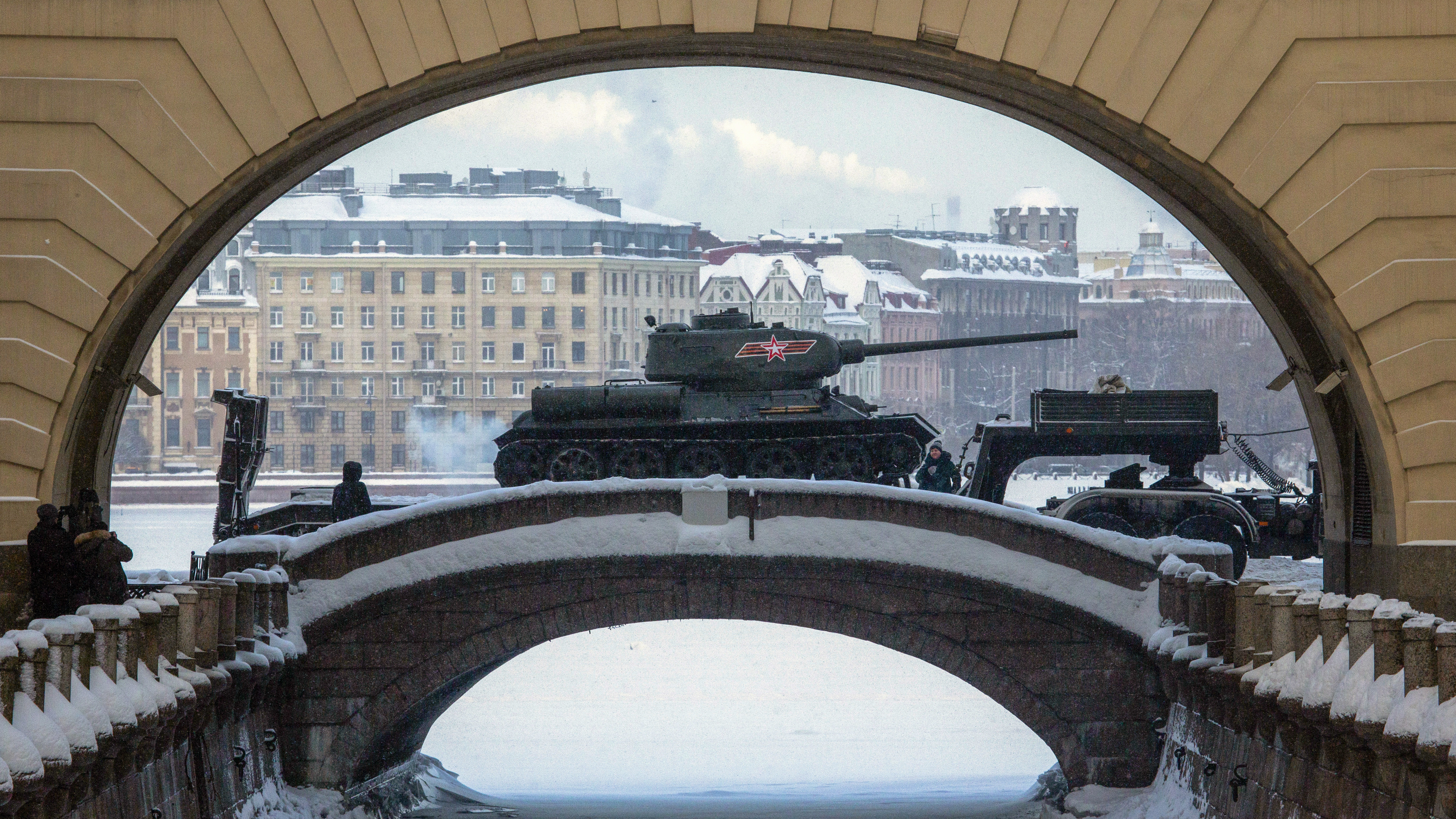 A Soviet World War II T-34 tank is transported by trucks after a rehearsal for the military parade which will take place at Dvortsovaya (Palace) Square on Jan. 27 to celebrate the 75th anniversary of the end of the Siege of Leningrad, in St.Petersburg, Russia, Thursday, Jan. 24, 2019. (AP Photo/Dmitri Lovetsky)