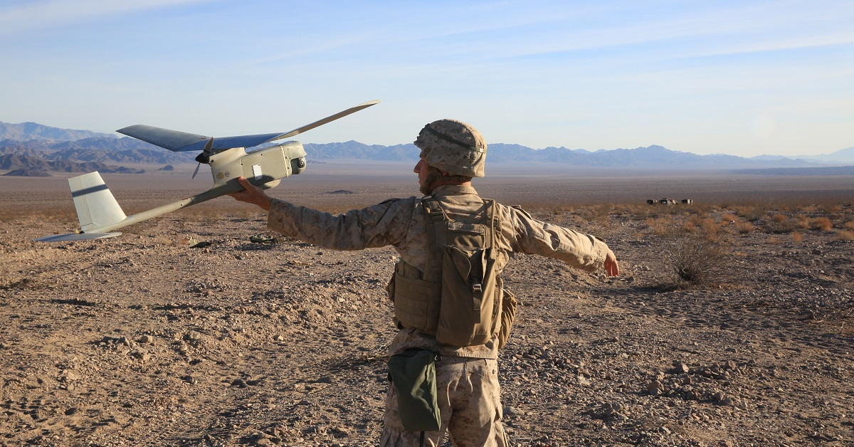 A Marine Air Ground Task Force intelligence officer prepares to launch an RQ-11B Raven Dec. 11, 2016. (Lance Cpl. Austin Mealy/Marine Corps)