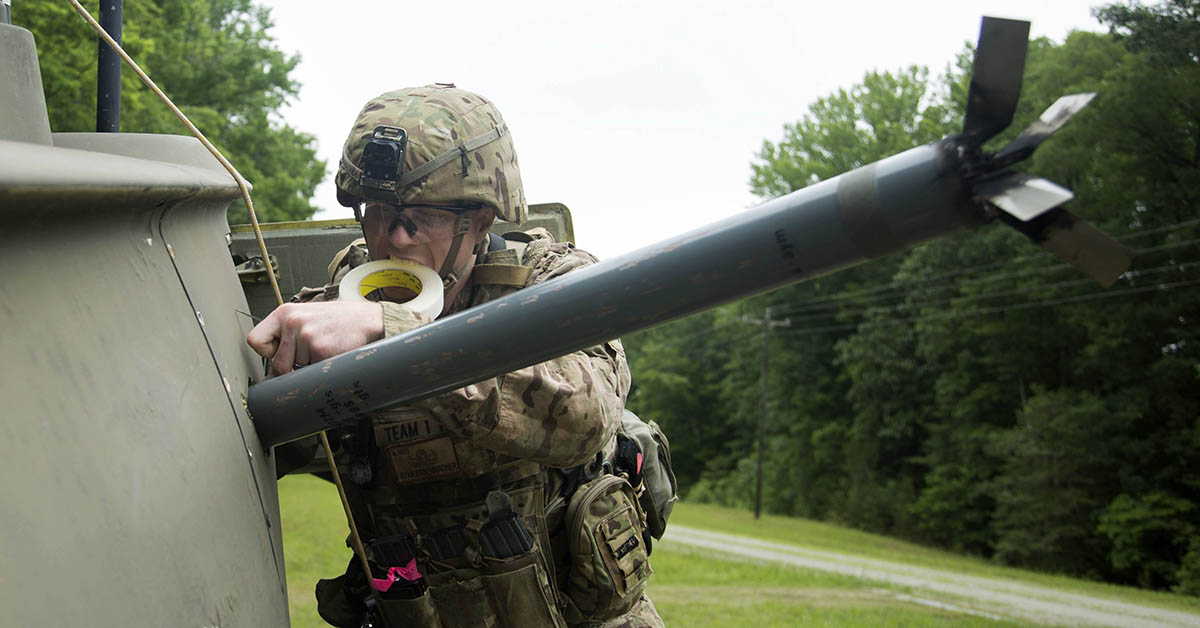 Staff Sgt. Ryan Essenmacher, an explosive ordnance disposal team leader with the 720th Ordnance Company (EOD) from Baumholder, Germany, prepares a simulated explosive for removal on the Crash Site lane at Fort A.P. Hill, June 3, 2018. EOD teams are assessed on operations and associated tasks required to provide EOD support to unified land operations to eliminate and/or reduce explosive threats. (SPC. Shekinah M. Frye/Army)