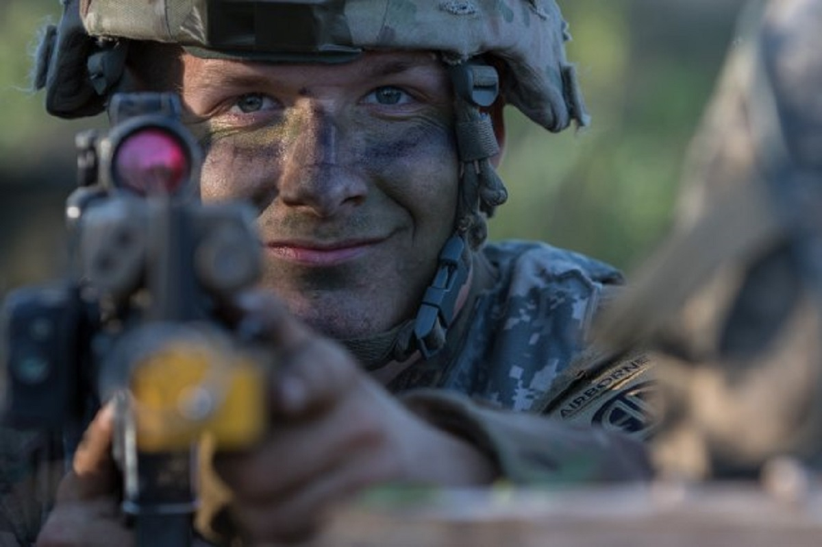 Spc. Lucas Underwood, a paratrooper assigned to the U.S. Army's 1st Battalion, 508th Infantry Regiment, 3rd Brigade Combat Team, 82nd Airborne Division, pulls security after jumping from an aircraft near Rukla, Lithuania, as part of Swift Response 18. (U.S. Army)