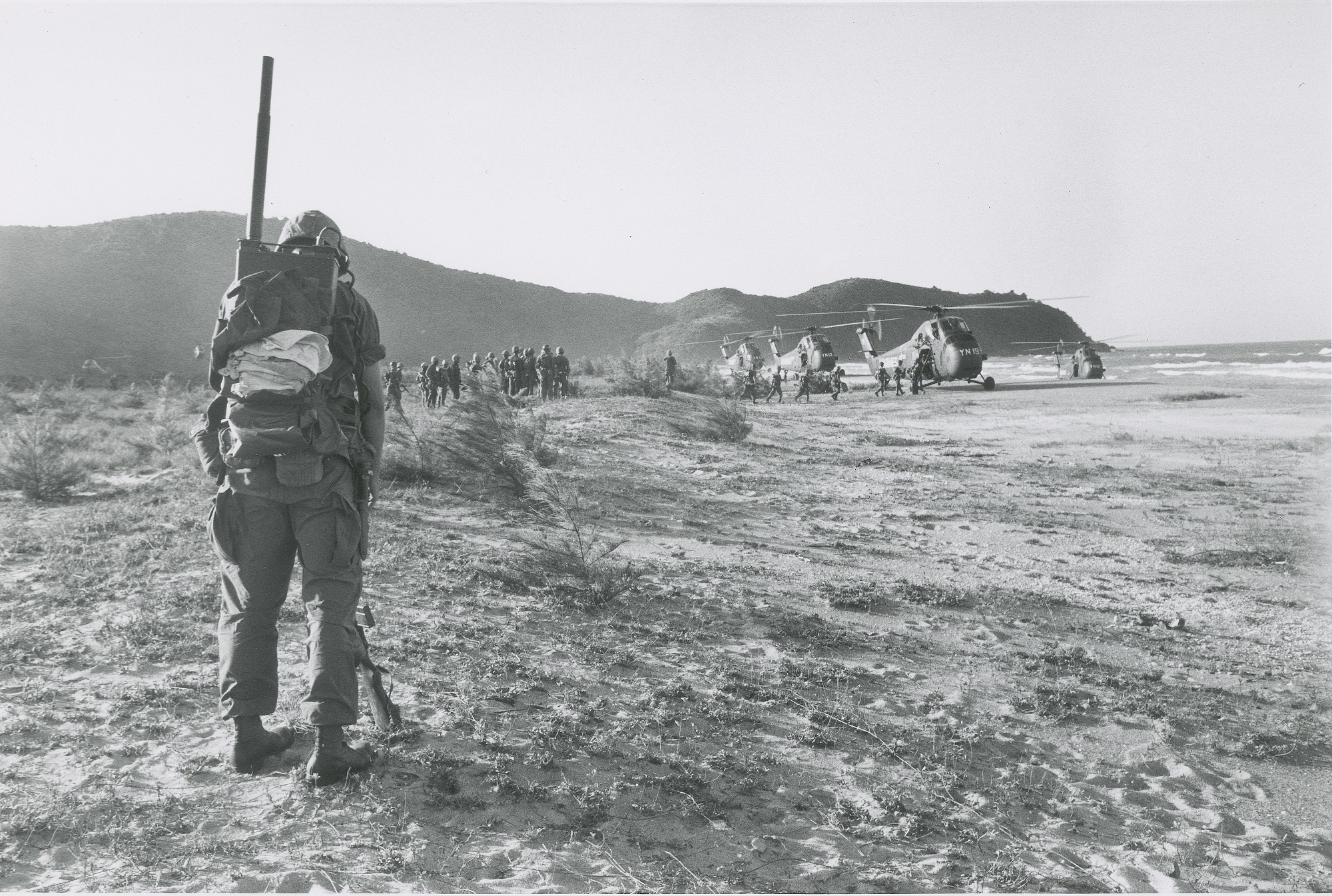 Marines wait to load helicopters, 1965. (Wisconsin Historical Images 115597)
