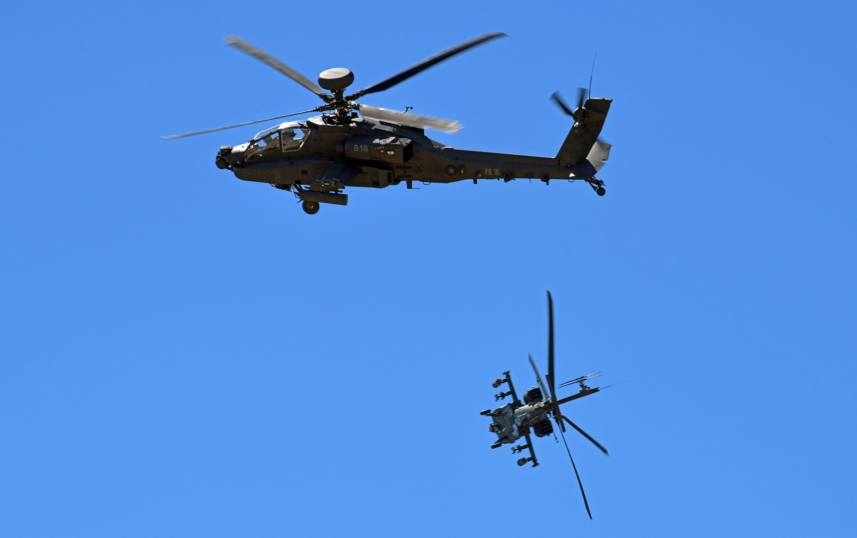 Two American-made AH-64E attack helicopters demonstrate their combat skills during a commissioning ceremony at an military base in Taoyuan, Taiwan, on July 17, 2018. (Sam Yeh/AFP via Getty Images)