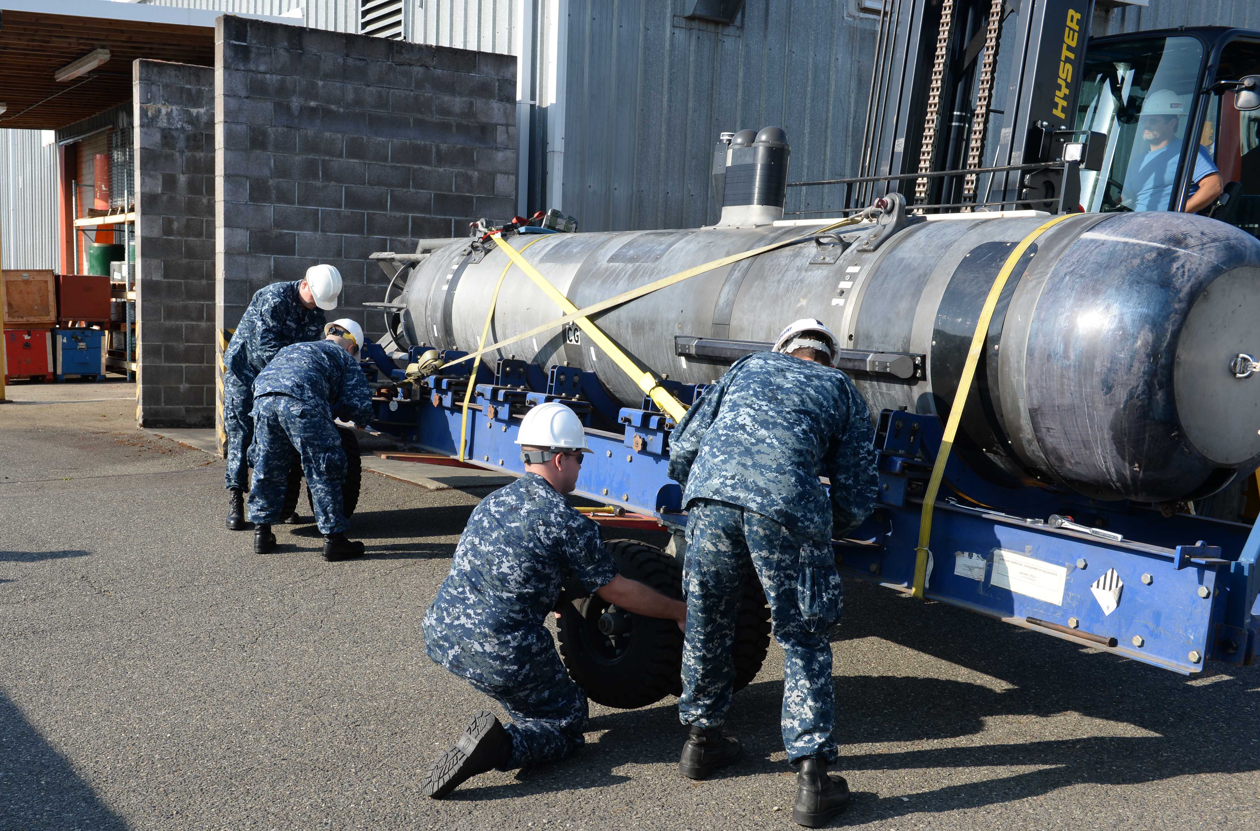 140822-N-MN975-012 KEYPORT, Wash. (Aug. 22, 2014) Sailors assigned to Commander, Submarine Development Squadron (CSDS) 5, Detachment Unmanned Undersea Vehicle, prepare Large Training Vehicle 38 (LTV 38), an unmanned undersea vehicle, to be unloaded at Naval Undersea Warfare Center-Keyport. LTV 38 is designed as a full-pressure hull vehicle, capable of both line of sight and over the horizon communications in support of intelligence, surveillance and reconnaissance (ISR) missions. (U.S. Navy photo by Mass Communication Specialist 2nd Class Justin A. Johndro/Released)