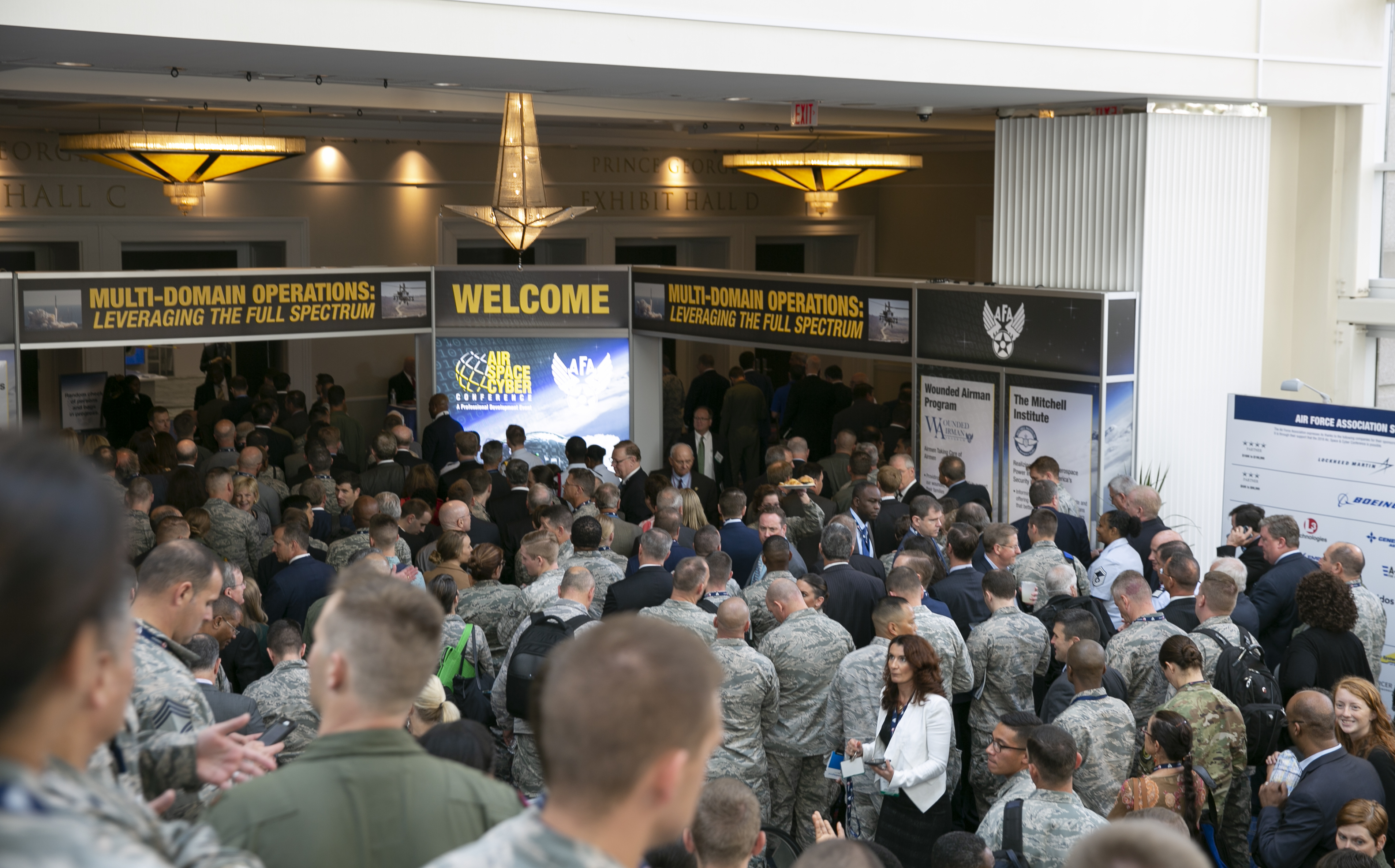 A huge crowd of Airmen wait to enter the exhibit floor at the Air Force Association's Air, Space, and Cyber conference while Vice President Pence was given a tour of the displays. (Alan Lessig/Staff)
