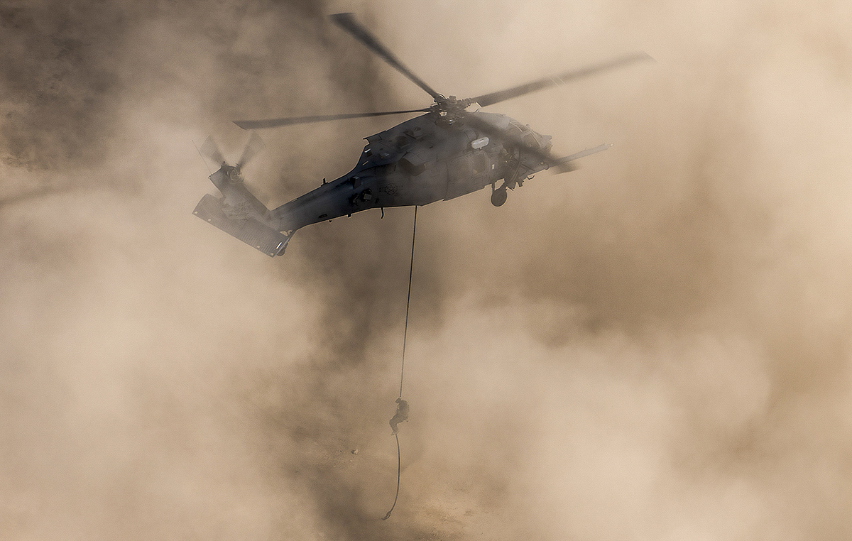 A pararescueman rappels out of an HH-60G Pave Hawk helicopter, assigned to the 66th Rescue Squadron, during training at Nellis Air Force Base, Nevada, Feb. 22, 2018. (Sr. Airman Kevin Tanenbaum/Air Force)