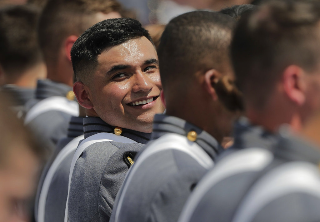 A West Point cadet looks back at other cadets who just received their diplomas during graduation ceremonies at the United States Military Academy, Saturday, May 26, 2018, in West Point, N.Y. (Julie Jacobson/AP)
