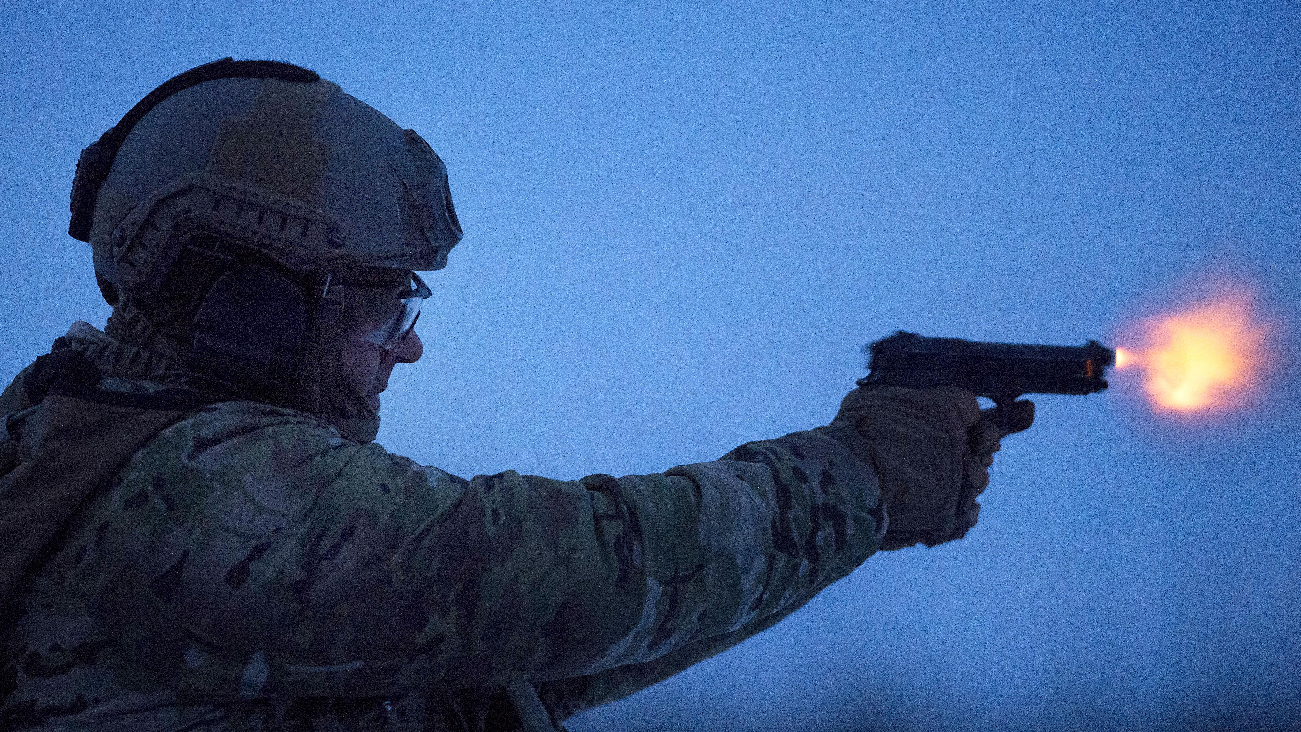 An airman fires an M9 pistol during small-arms live-fire sustainment training at Joint Base Elmendorf-Richardson, Alaska, Nov. 29, 2017. The airman is assigned to the 3rd Air Support Operations Squadron. Air Force photo by Alejandro Peña