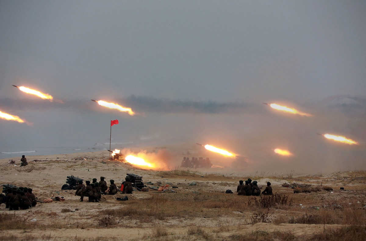 A firing contest takes place among North Korean female gunners with multiple launch rocket systems at an undisclosed location. (STR/AFP via Getty Images)