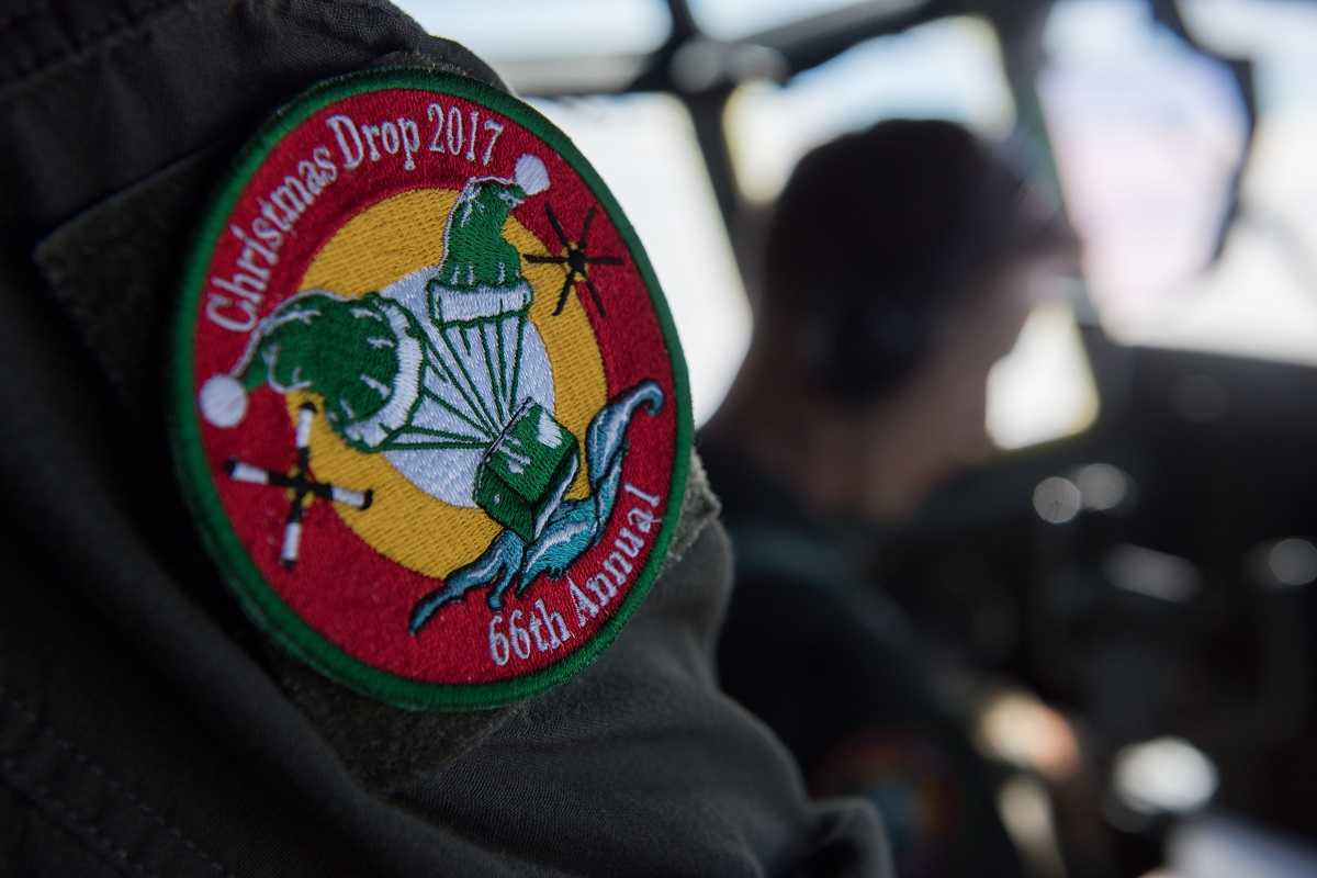 A pilot assigned to the 36th Airlift Squadron wears an Operation Christmas Drop 2017 patch, Dec. 14, 2017, at Andersen Air Force Base, Guam. OCD is the longest running Department of Defense humanitarian airlift training operation and will provide nearly 25 tons of critical supplies to 56 Micronesian islands this year impacting about 20,000 people. (Airman 1st Class Juan Torres Chardon/Air Force)