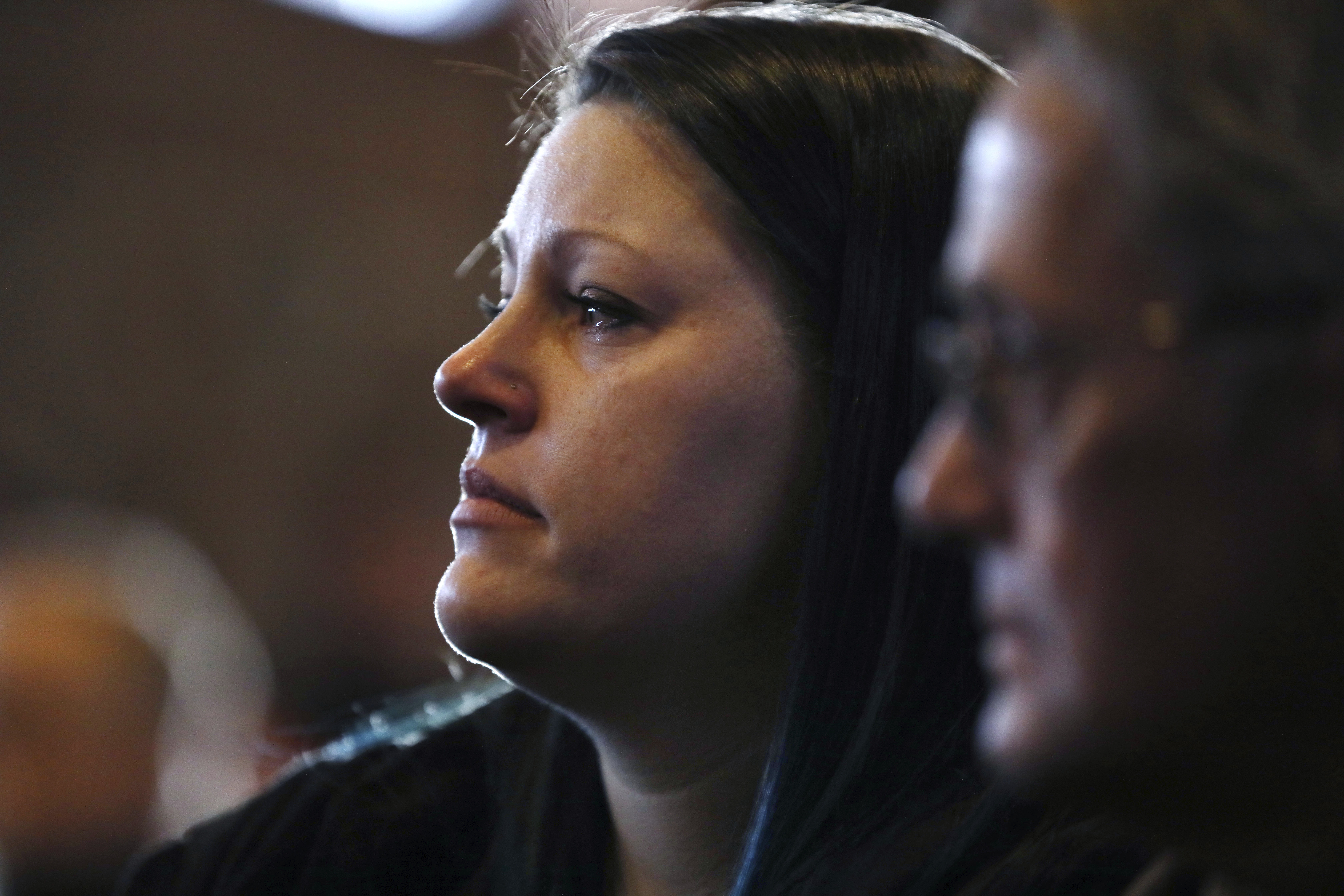Tears fall down the face of Meagan Knudson during the funeral service for WWII Marine veteran Cpl. Remigio