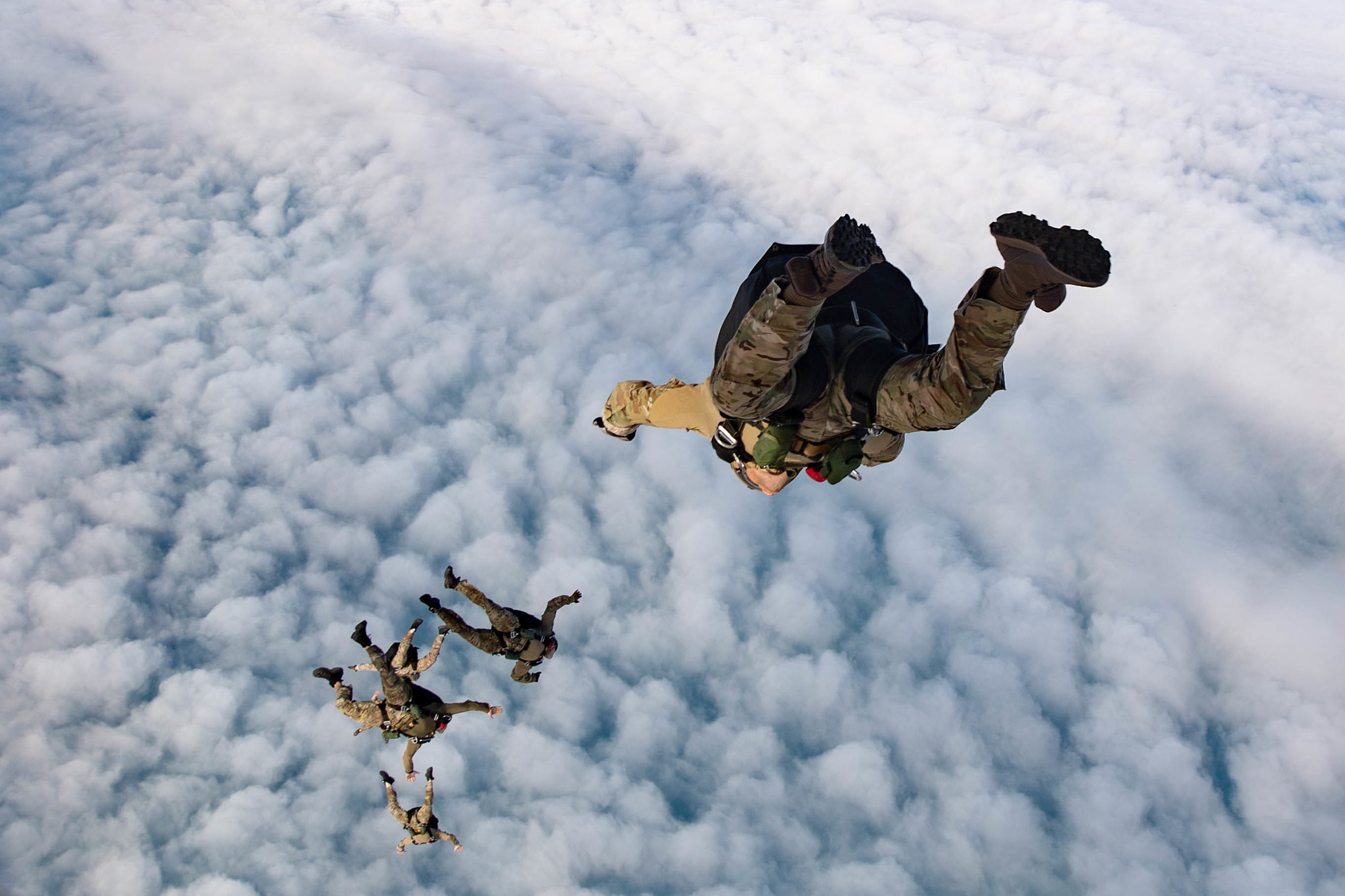 Explosive ordnance disposal technicians conduct unstable exit free fall jumps as part of flight operations with the Spanish navy on Feb. 13, 2020, in Rota, Spain. (Mass Communication Specialist 3rd Class Katie Cox/Navy)