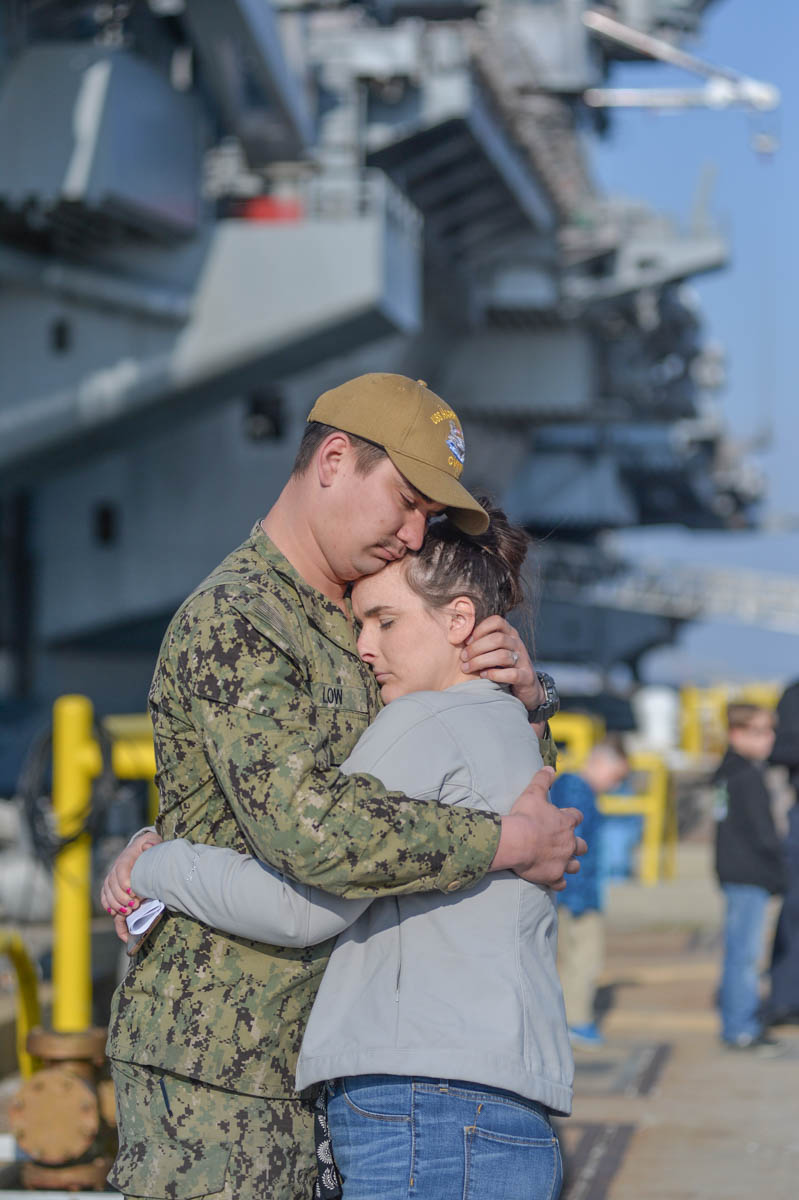 Norfolk, Va. (April 11, 2018) Aviation Boatswains Mate Third Class Chaz Low and his wife Elizabeth share a few last moments prior to Low boarding the Truman and departing on deployment (photo by Harold J. Gerwien).