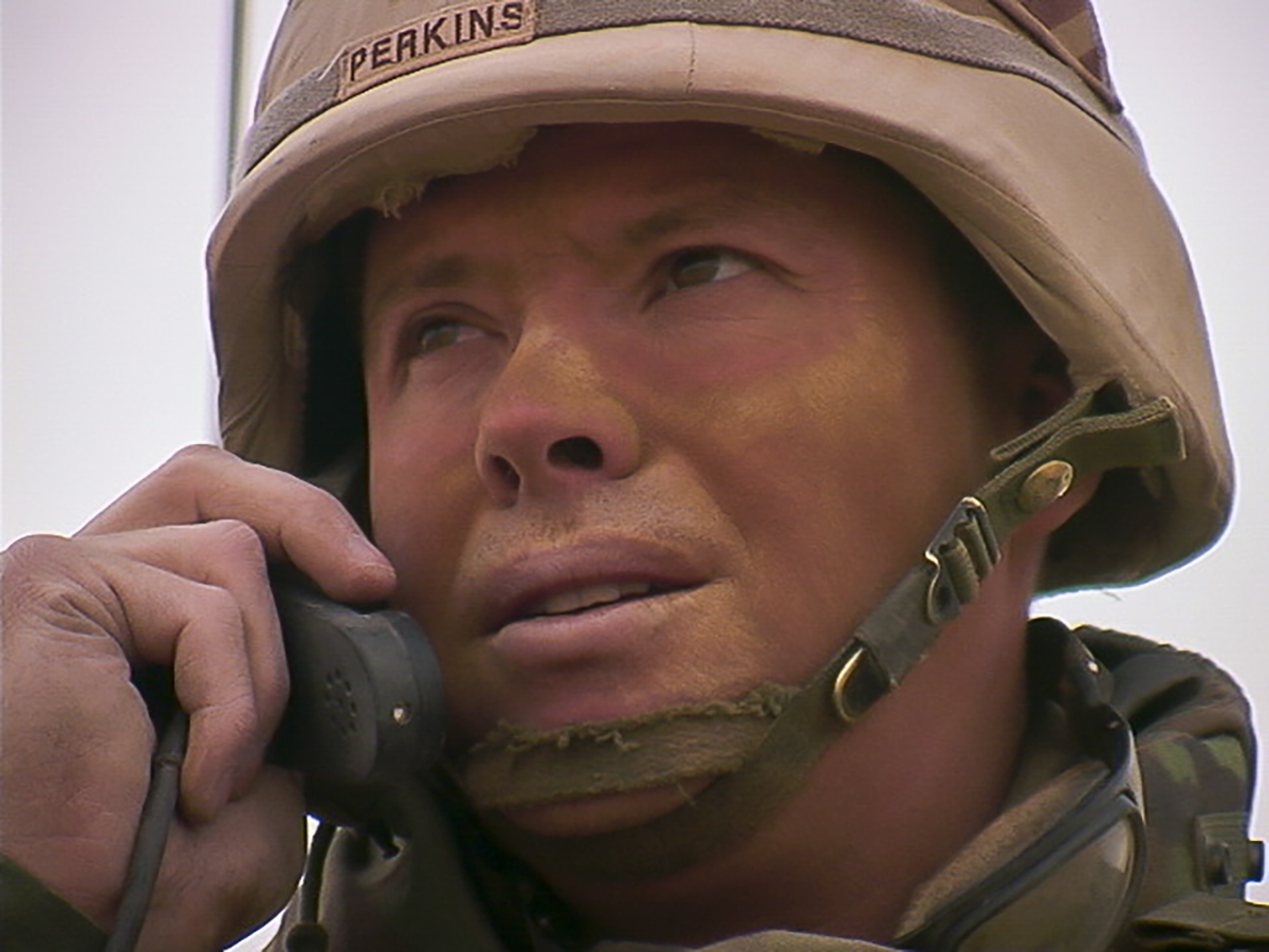 """Col. David Perkins, Spartan 6, receives updates and issues his intent during the """"Thunder Run"""" into Baghdad in March 2003. (Army)"""