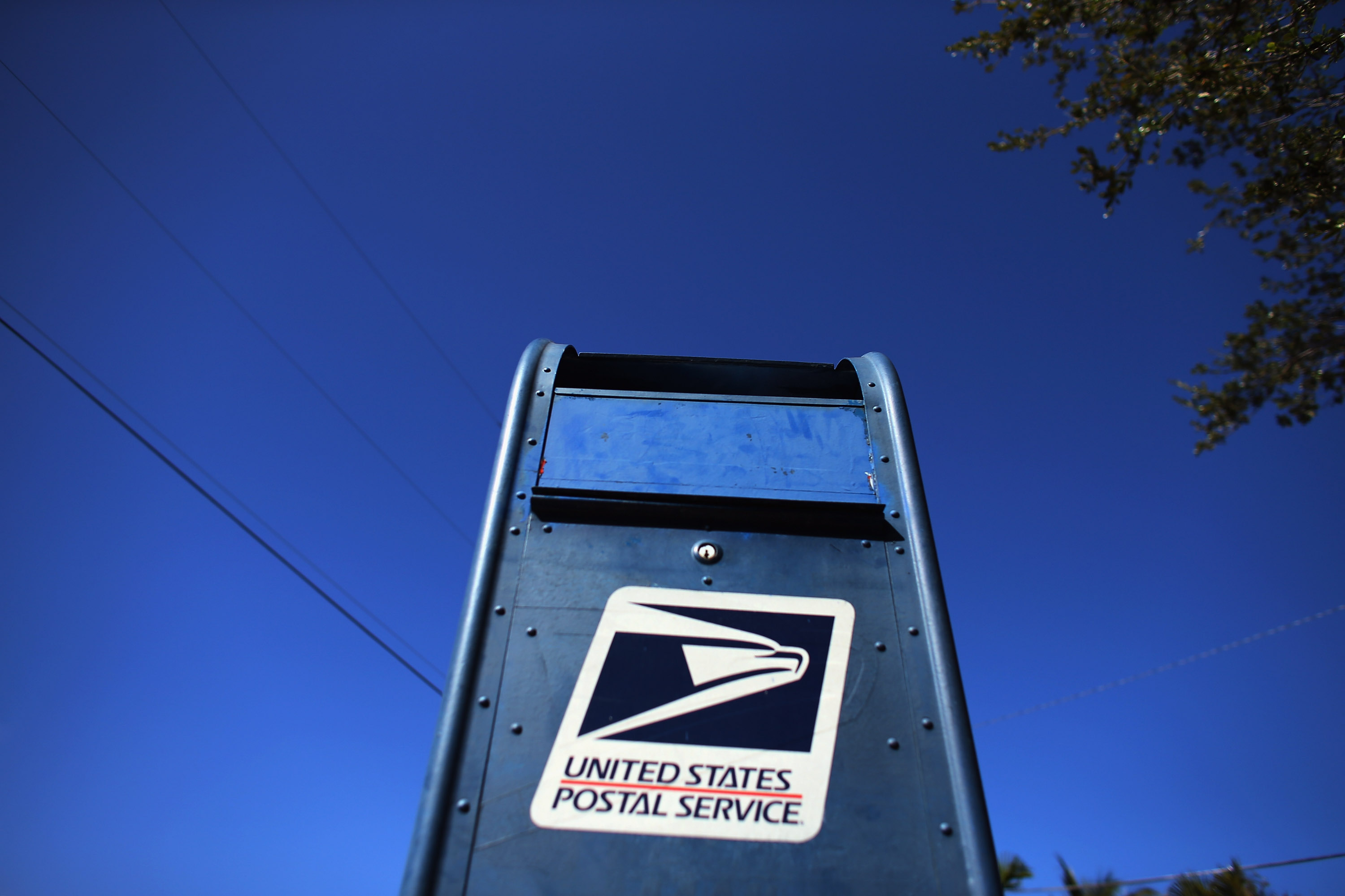 The U.S. Postal Service's $8.8 billion in losses for 2019 may be down to requirements places on the agency, rather than its business plan. (Joe Raedle/Getty Images)