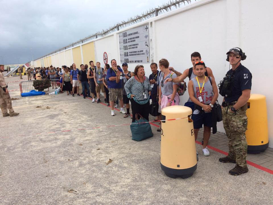 The New York National Guard's 106th Rescue Wing assists in airlifting U.S. citizens stranded in St. Martin on Sept. 9, 2017, after Hurricane Irma devastated the island, with HC-130 King aircrews, maintainers, rescue teams and other Airmen from New York, Puerto Rico and Kentucky to name a few. (Maj. Sean Boughal/National Guard)