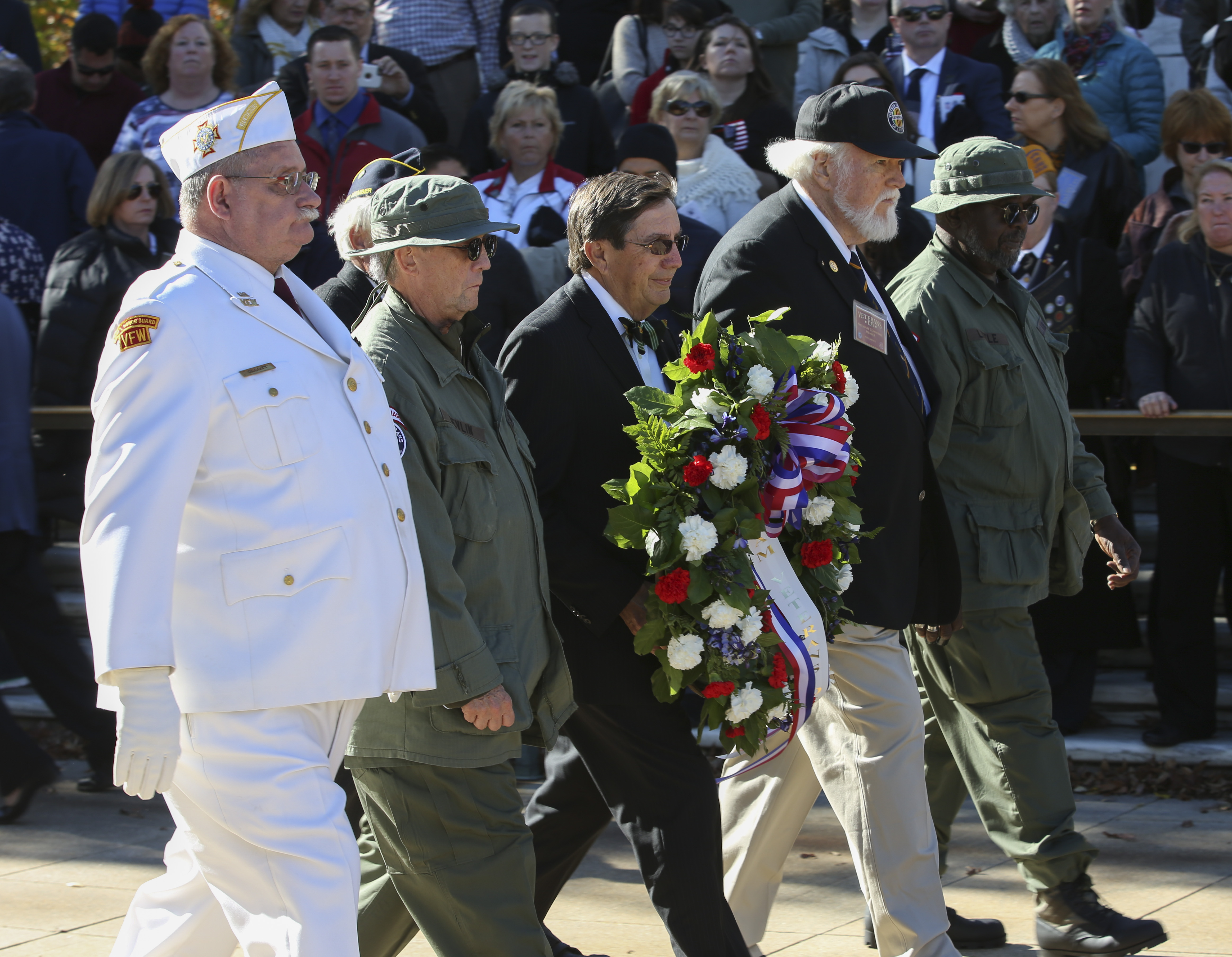 Members of the Vietnam Veterans of America carry a wreath to lay beside the Tomb of the Unknown Soldier at Arlington National Cemetery.