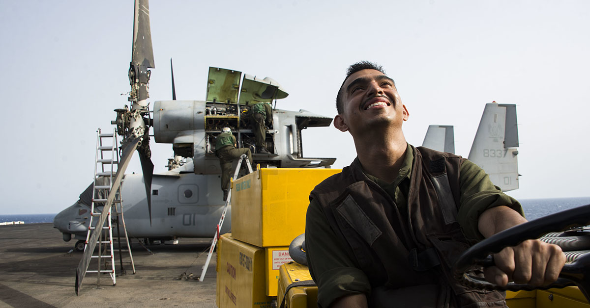Lance Cpl. Juan Rocha, assigned to the 26th Marine Expeditionary Unit, cleans the flight deck aboard the Wasp-class amphibious assault ship USS Iwo Jima (LHD 7), July 02, 2018. Iwo Jima is deployed to the U.S. 5th Fleet area of operations in support of naval operations to ensure maritime stability and security in the Central region, connecting the Mediterranean and the Pacific through the western Indian Ocean and three strategic choke points. (MC3 Dominick A. Cremeans/Navy)