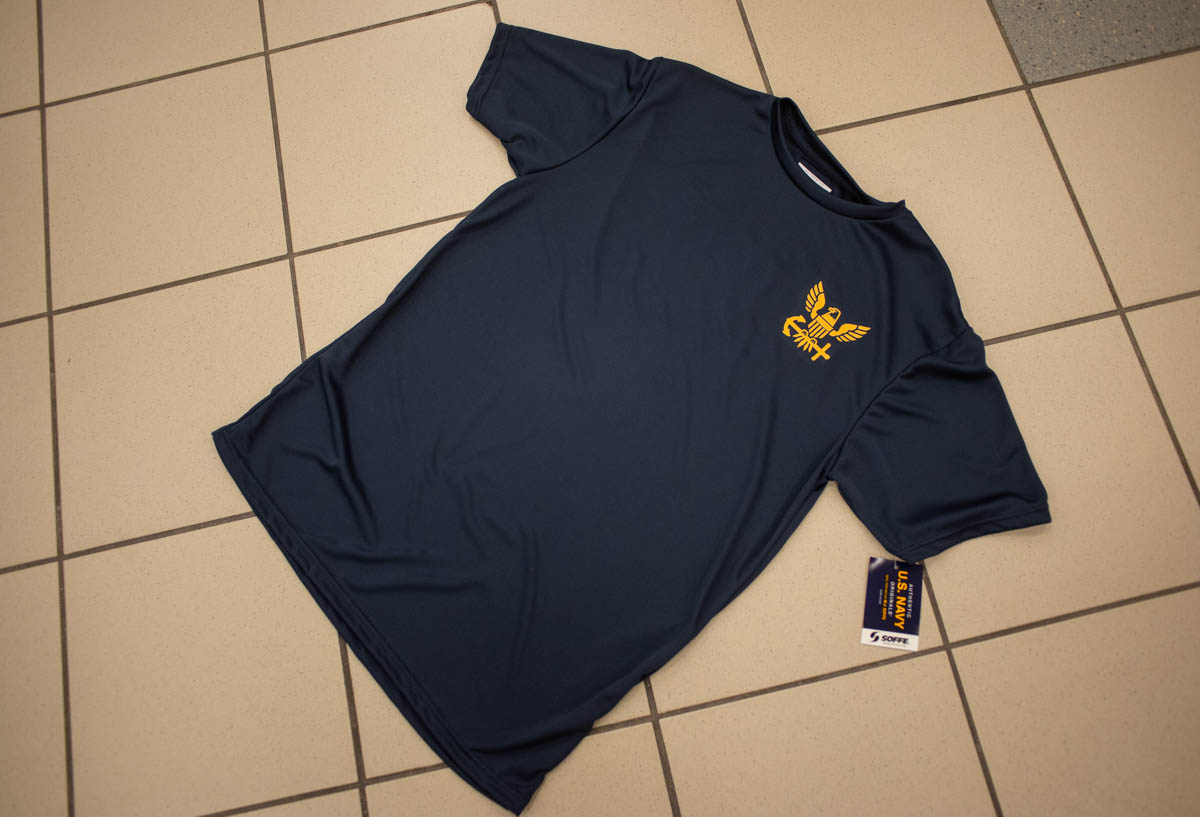 The Navy's new physical training shirt is for sale in Navy Exchange Uniform Stores. (Mark D. Faram/Staff)