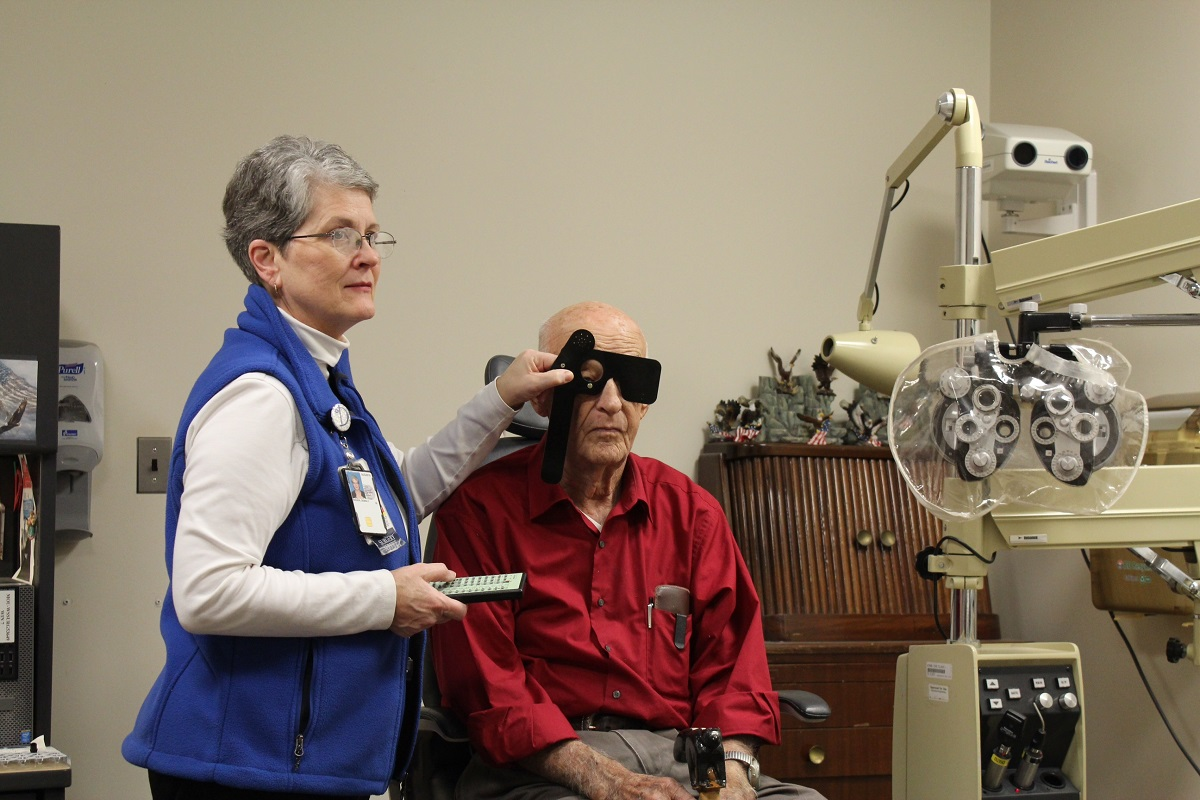 An ophthalmology health technician conducts an eye exam for a veteran at a VA healthcare facility. A new report this week found the Veterans Affairs department may be ordering tens of thousands of unnecessary medical appointments each year. (Veterans Affairs)
