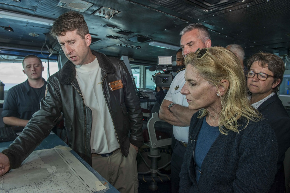 Truman's commanding officer, Capt. Nicholas Dienna, left, shows U.S. ambassador to the French Republic and Principality of Monaco Jamie McCourt the aircraft carrier's position on a chart on the bridge. (U.S. Navy)
