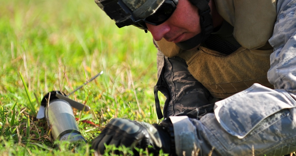 An airman from Patrick Air Force Base performs initial reconnaissance on simulated unexploded ordnance in 2010. A Patrick explosives team removed a training rocket from a garden in Vero Beach, Florida, Thursday. (Jennifer Macklin/Air Force)