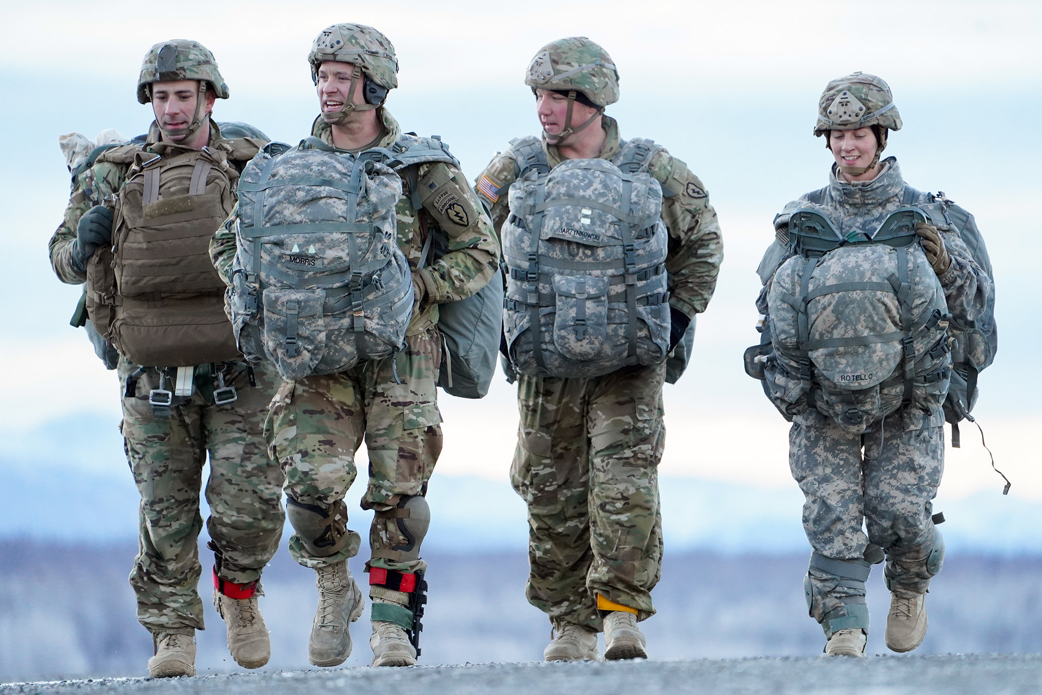 Soldiers make their way to a rally point after conducting a parachute jump on Malemute drop zone at Joint Base Elmendorf-Richardson, Alaska, Dec. 11, 2019. (Justin Connaher/Air Force)
