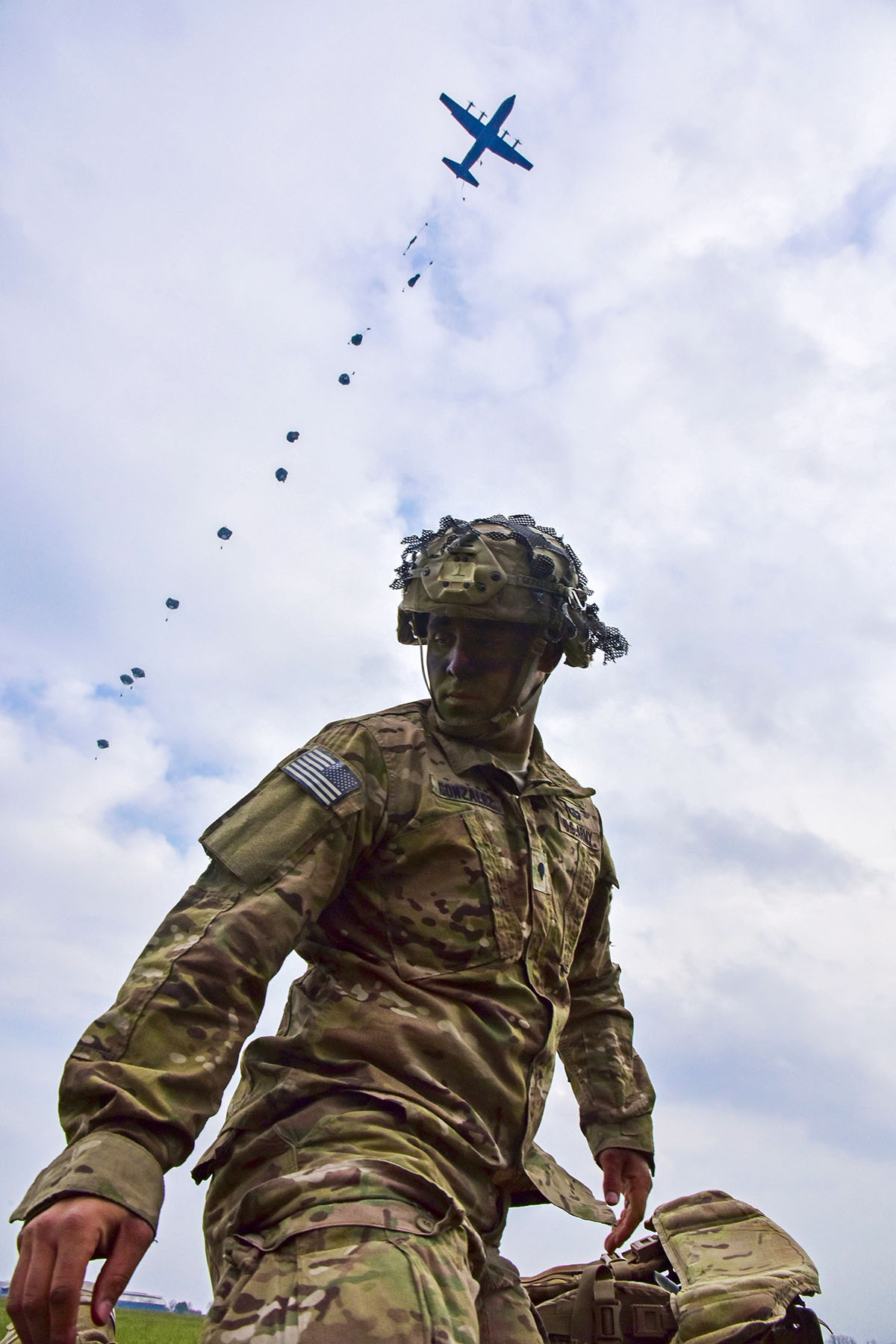 A U.S. Army Paratroopers assigned to the 2nd Battalion, 503rd Infantry Regiment, 173rd Airborne Brigade, secures his equipment after an airborne operation from a U.S. Air Force C-130 Hercules aircraft at Juliet Drop Zone in Pordenone, Italy April 10, 2018. The 173rd Airborne Brigade is the U.S. Army Contingency Response Force in Europe, capable of projecting ready forces anywhere in the U.S. European, Africa or Central Commands' areas of responsibility. (Paolo Bovo/Army)
