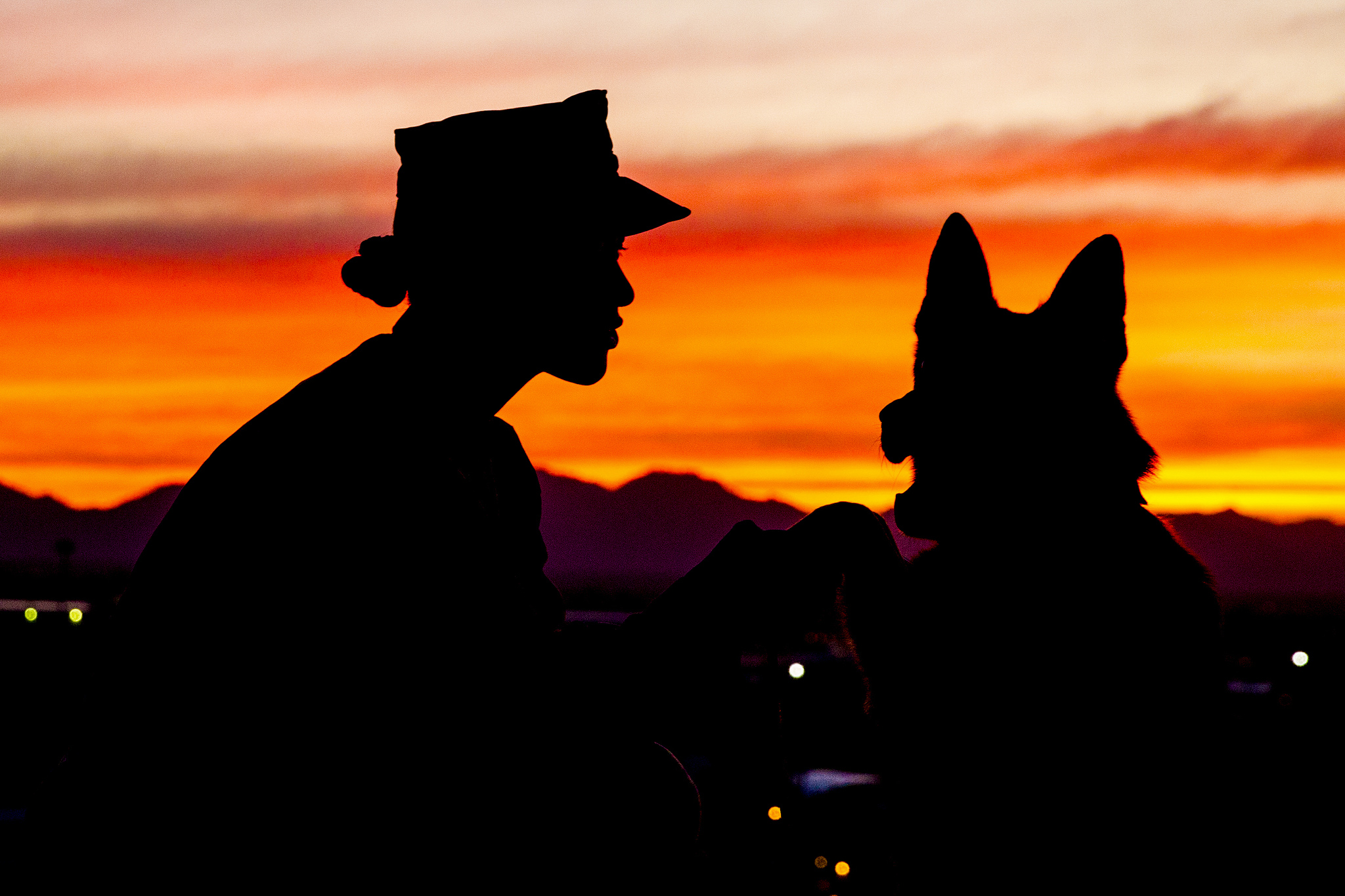 Dog handler Sgt. Jenna L. Cauble poses for a photo with her military working dog, Ken, on Marine Corps Air Station Yuma, Ariz., on Jan. 18, 2019. (Sgt. Allison Lotz/Marine Corps)