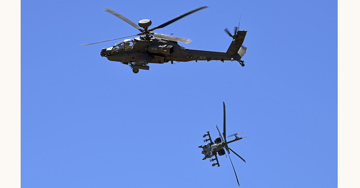 Two American-made AH-64E Apache attack helicopters demonstrate combat skills during a commissioning ceremony for the Taiwanese Army. The South Korean Army operates two battalions of 36 AH-64E helos. (Sam Yeh/AFP via Getty Images)