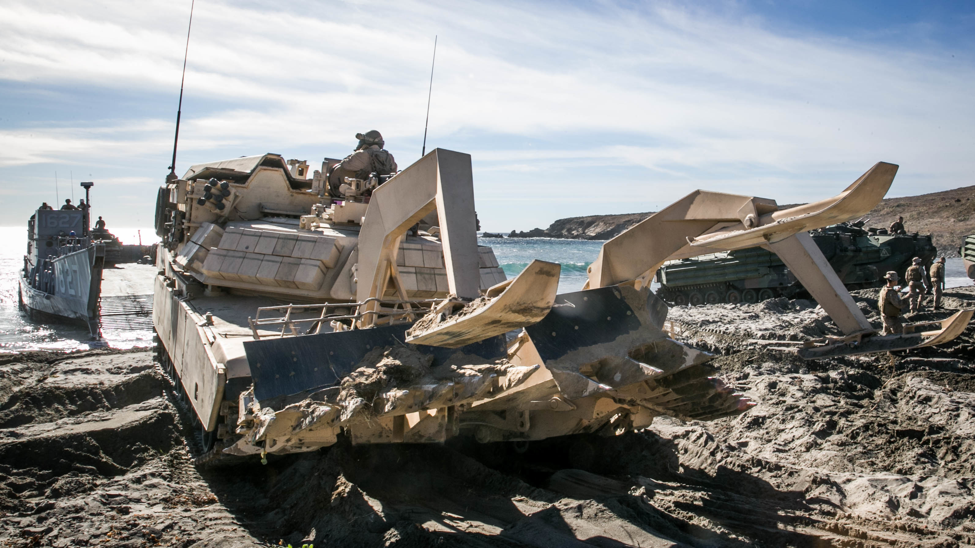 The armor and protuberances from this vehicle look intimidating, but what will make it all work are the cameras that allow Marines inside the vehicle to operate while safely ensconced in the armored interior. (Rhita Daniel, USMC)