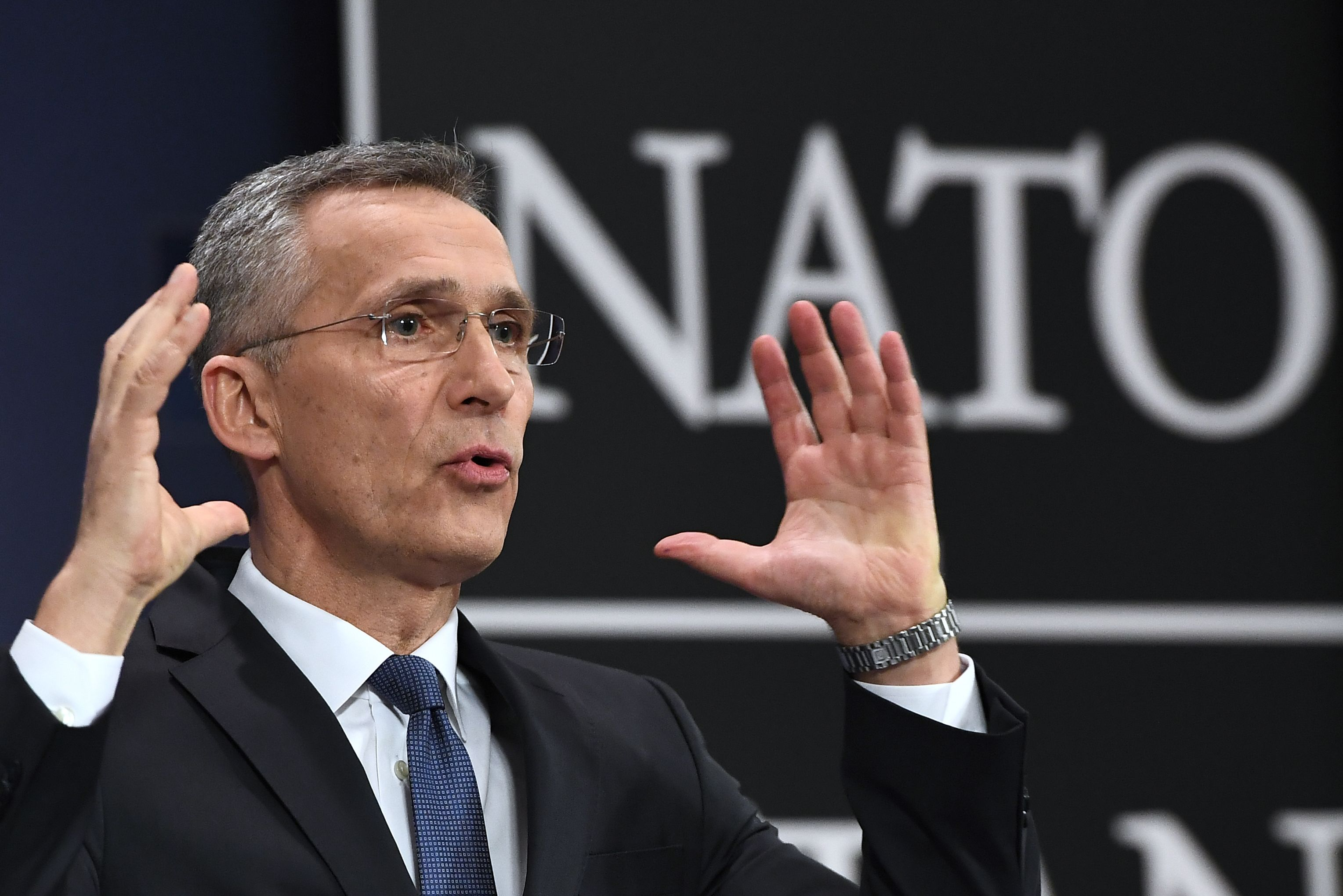 NATO Secretary General Jens Stoltenberg gestures as he addresses a news conference to give the alliance's annual report at NATO headquarters in Brussels on March 15, 2018. (Emmanuel Dunand/AFP via Getty Images)