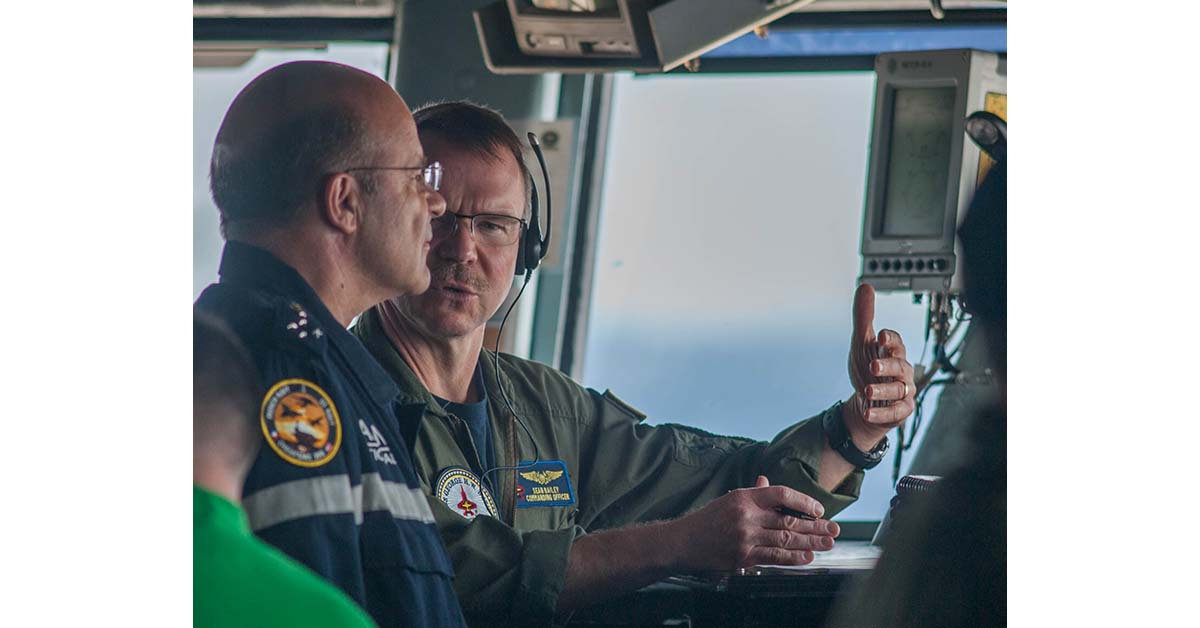 Capt. Sean Bailey, commanding officer of the aircraft carrier George H.W. Bush, explains flight deck operations to the Chief of the French Navy, Adm. Christophe Prazuck, on May 13, 2018. (Mark D. Faram/Staff)