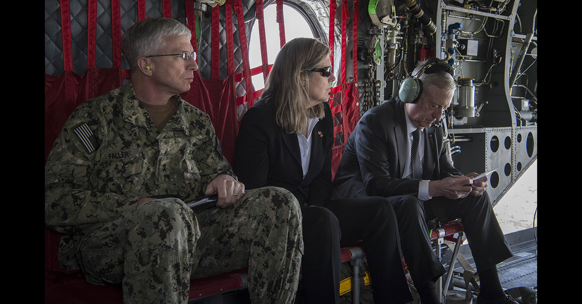 Then-Navy Rear Adm. Craig Faller, left, has been nominated to lead U.S. Southern Command. Pictured: Secretary of Defense Jim Mattis, right, travels via a CH-47 Chinook helicopter to Headquarters Resolute Support in Kabul, Afghanistan, April 24, 2017. To his left are Faller, his senior military assistant, and Sally Donnelly, his senior adviser. (Air Force Tech. Sgt. Brigitte N. Brantley/DoD)