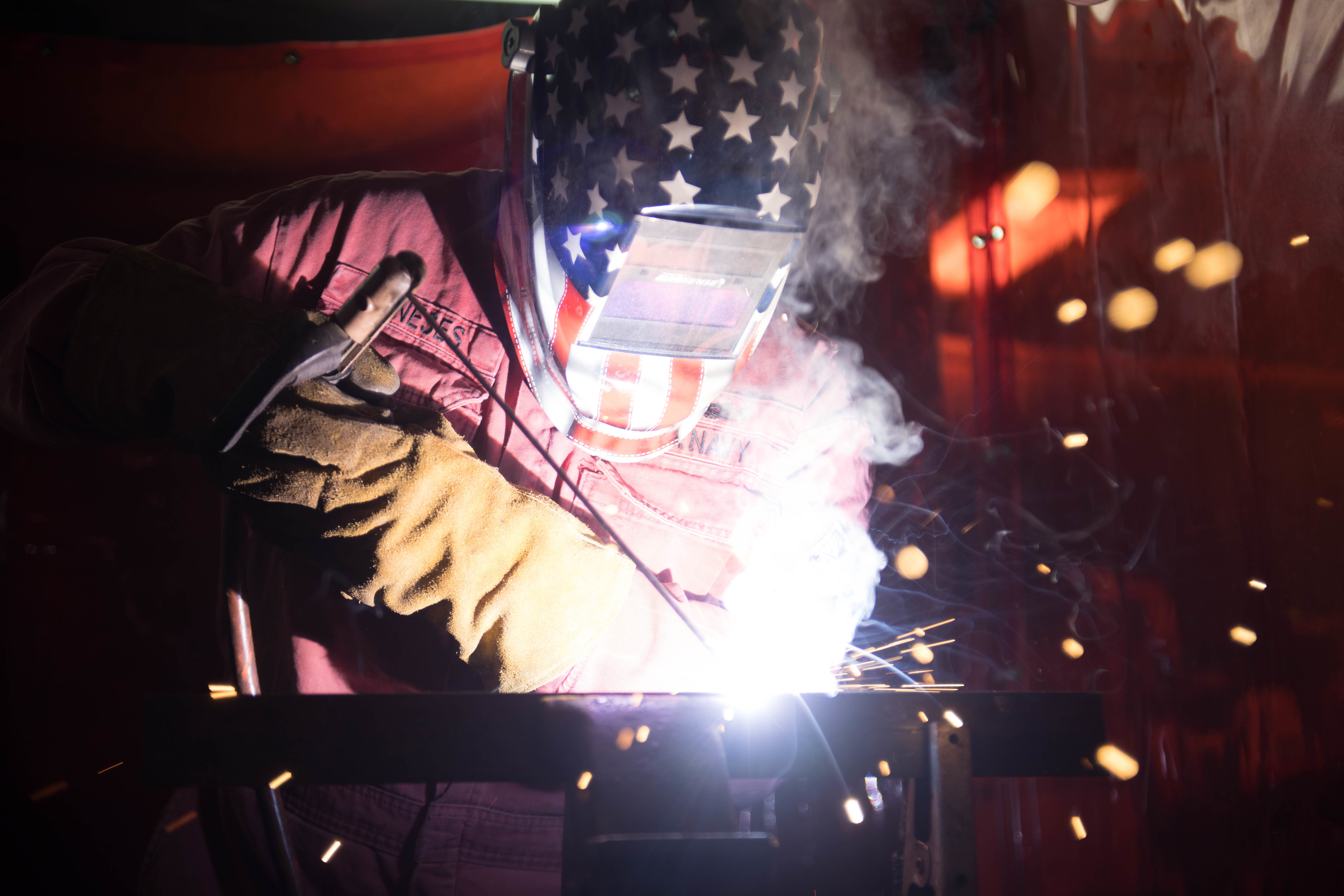 U.S. Navy Hull Maintenance Technician 2nd Class Michael Meneses uses a welder aboard the guided-missile destroyer Chung-Hoon. (MC2 Logan C. Kellums/U.S. Navy)